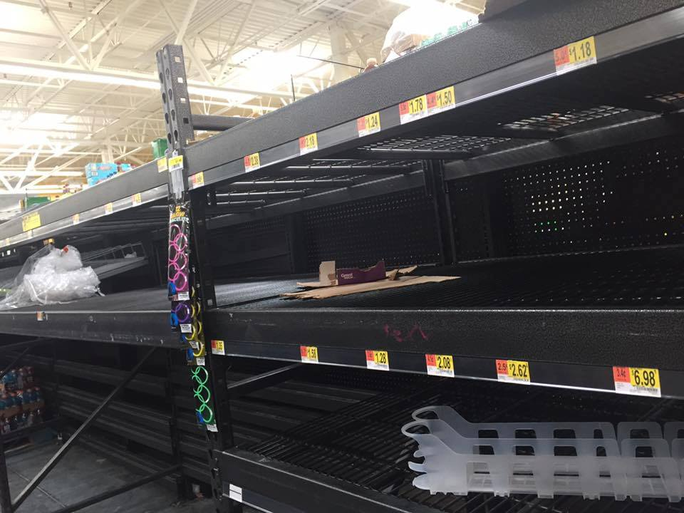 Bottled water shelves cleared out at the Walmart on 34th in Gainesville. Courtesy Bill Powell.