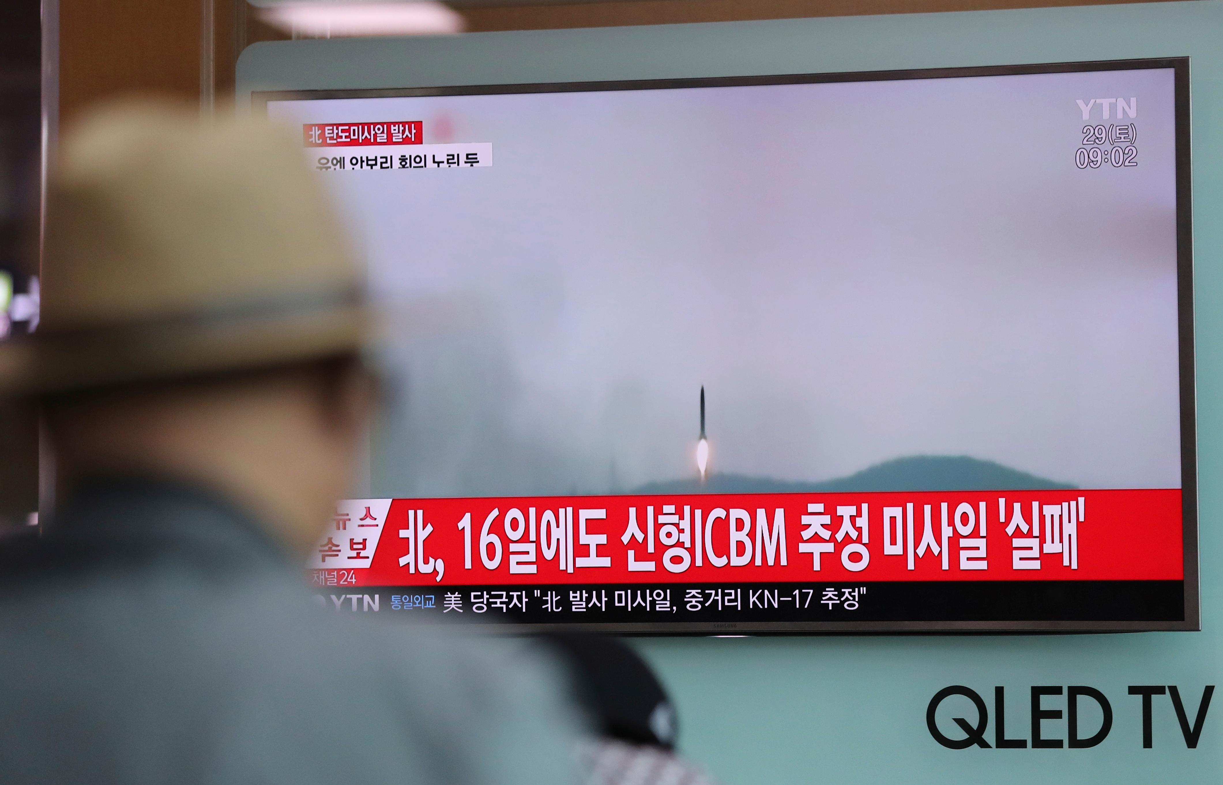 "A man watches a TV news program reporting about North Korea's missile firing with a file footage, at Seoul Train Station in Seoul, South Korea, Saturday, April 29, 2017. A North Korean mid-range ballistic missile apparently failed shortly after launch Saturday, South Korea and the United States said, the second such test-fire flop in recent weeks but a clear message of defiance as a U.S. supercarrier conducts drills in nearby waters. The letters on top left, reading ""North Korea fired a ballistic missile."" (AP Photo/Lee Jin-man)"