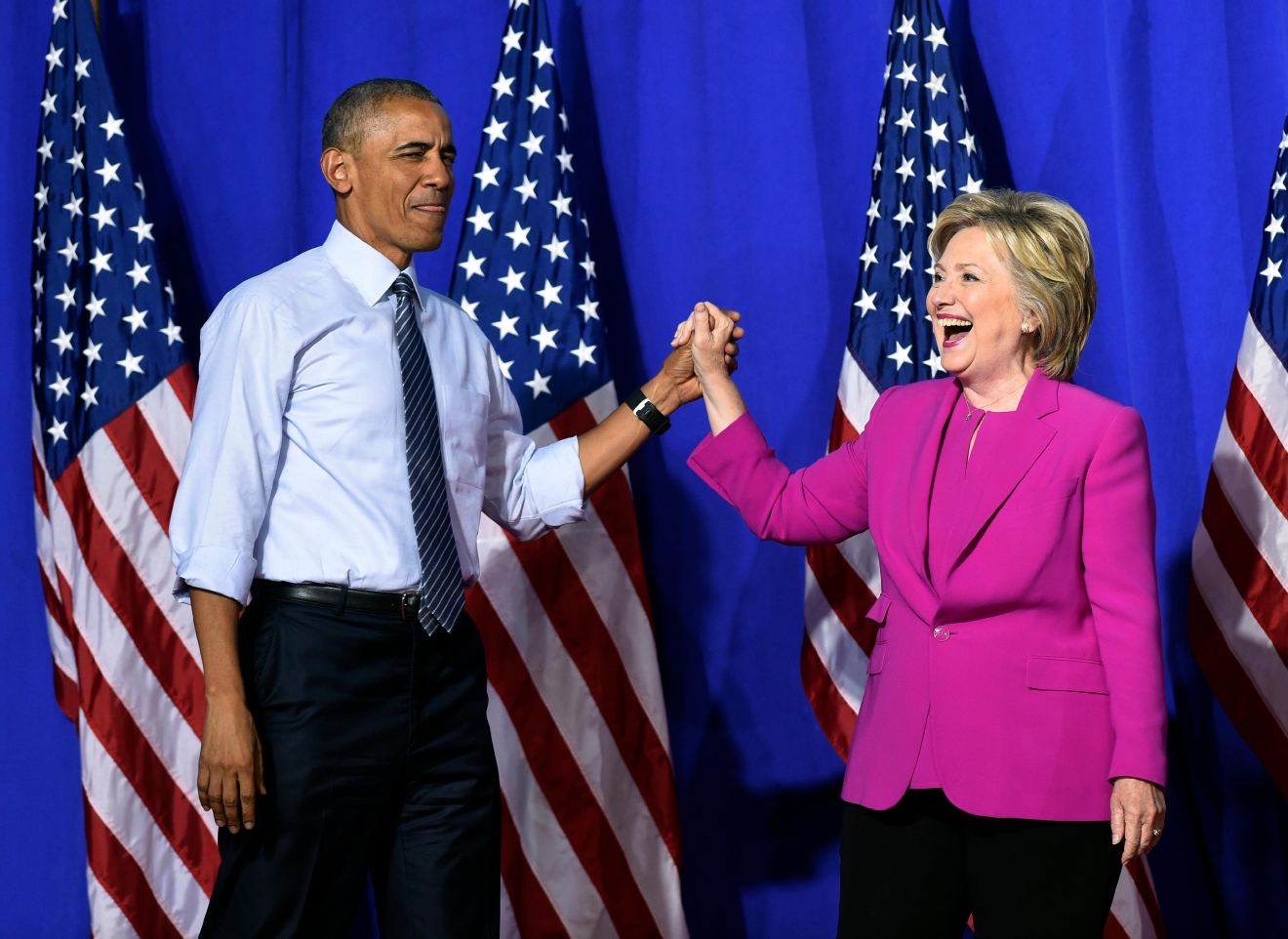 President Barack Obama and Democratic presidential candidate Hillary Clinton arrive at a campaign event at the Charlotte Convention Center in Charlotte, N.C., Tuesday, July 5, 2016. Obama is spending the afternoon campaigning for Clinton. (AP Photo/Susan Walsh)