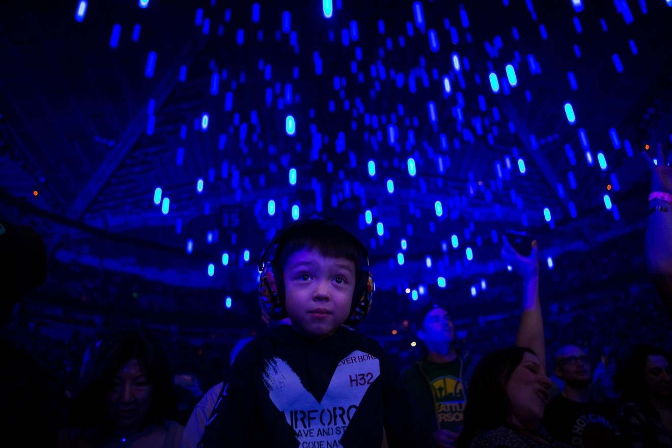 A young fan rocks headphones during the Red Hot Chili Peppers' performance at KeyArena. (Sy Bean / Seattle Refined)