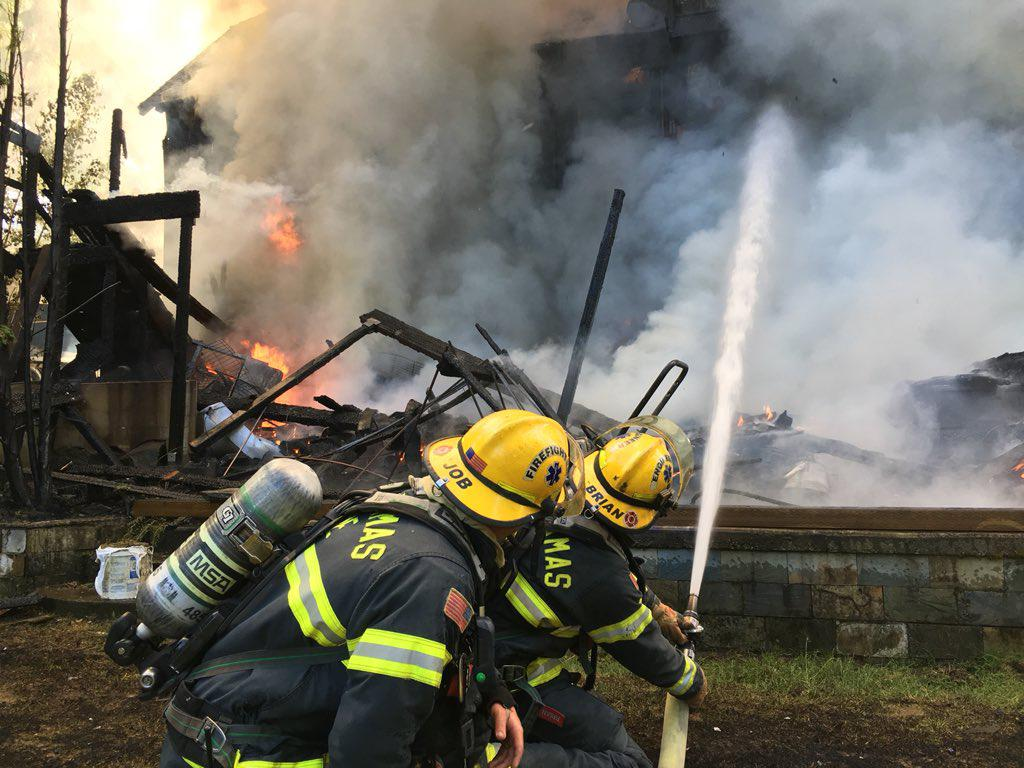 Clackamas firefighters battle a house fire on Mt. Scott Boulevard Monday night in Happy Valley. (Photo: Clackamas Fire)