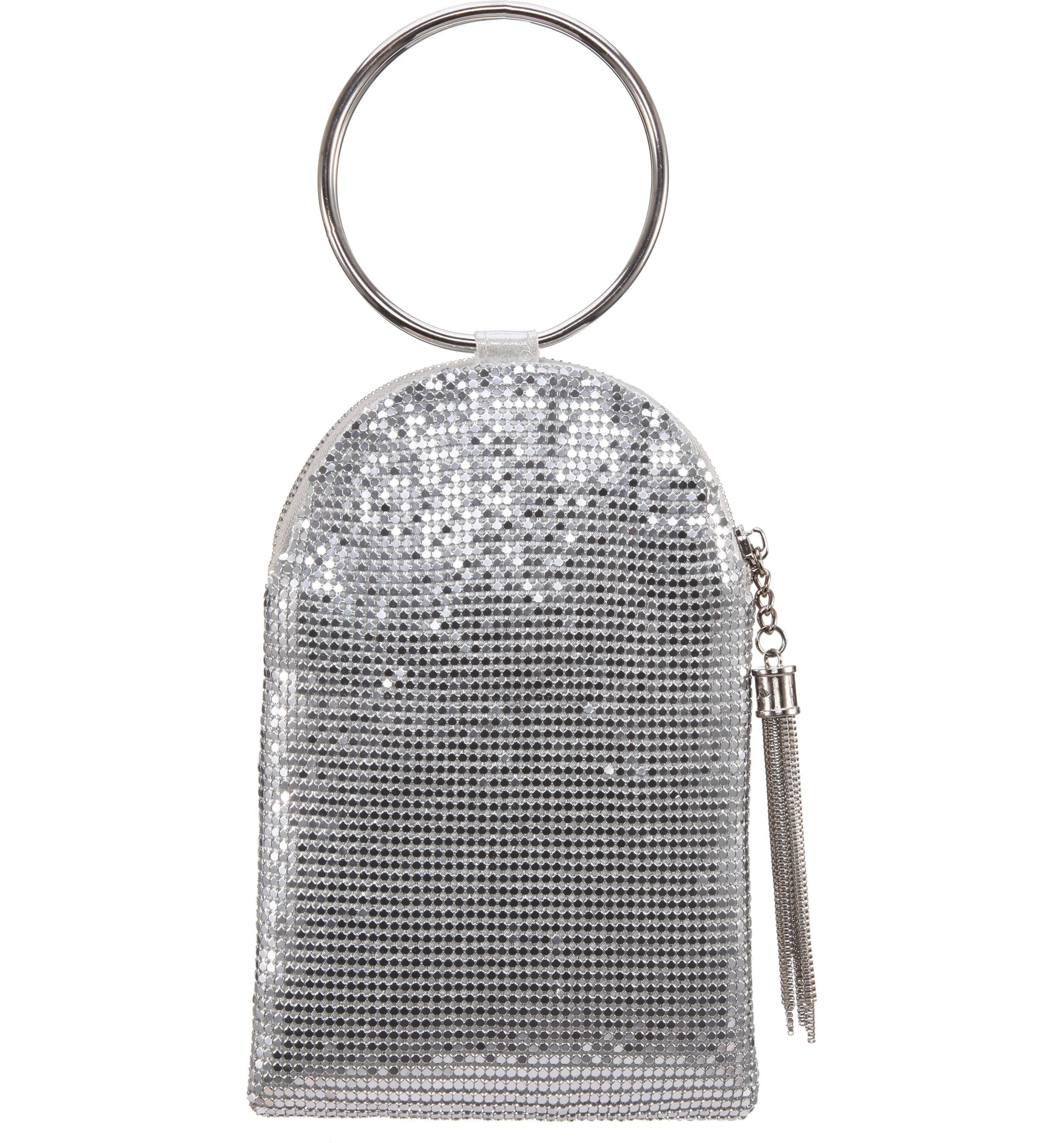 "<p>Circle handles are shaping up to be the on-trend look this season, and this sparkling bag lets you show it off in a big way. $58</p><p><a  href=""https://shop.nordstrom.com/s/nina-metallic-mesh-handbag/4991078/full?origin=category-personalizedsort&breadcrumb=Home%2FWomen%2FShop%20by%20Occasion%2FNight%20Out&color=rose%20gold"" target=""_blank"" title=""https://shop.nordstrom.com/s/nina-metallic-mesh-handbag/4991078/full?origin=category-personalizedsort&breadcrumb=Home%2FWomen%2FShop%20by%20Occasion%2FNight%20Out&color=rose%20gold"">Shop it{&nbsp;}</a></p><p>(Image: Nordstrom){&nbsp;}</p>"