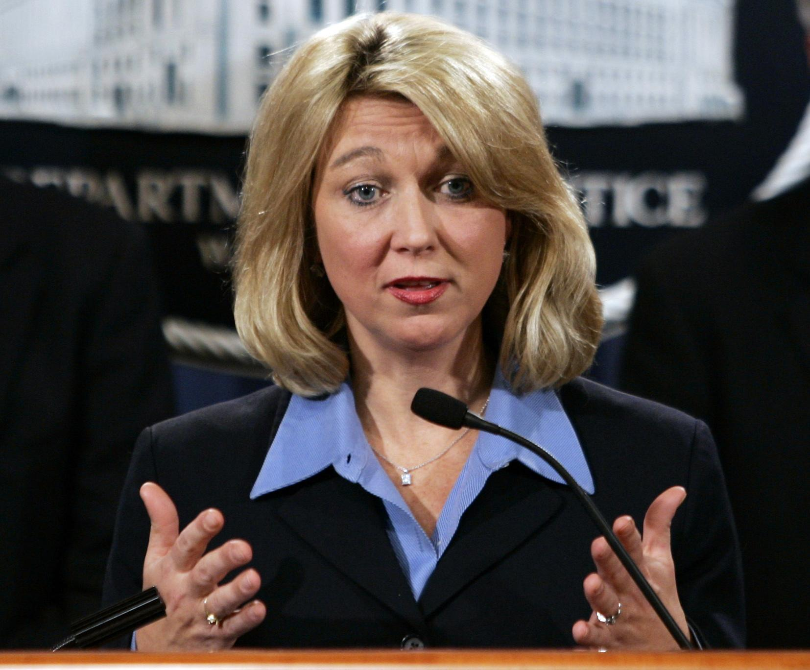 FILE - In this Jan. 3, 2006, file photo, then-Assistant Attorney General for the Criminal Division Alice Fisher briefs reporters at the Justice Department in Washington. President Donald Trump is considering nearly a dozen candidates to succeed ousted FBI Director James Comey, choosing from a group that includes several lawmakers, attorneys and law enforcement officials. (AP Photo/J. Scott Applewhite, File)