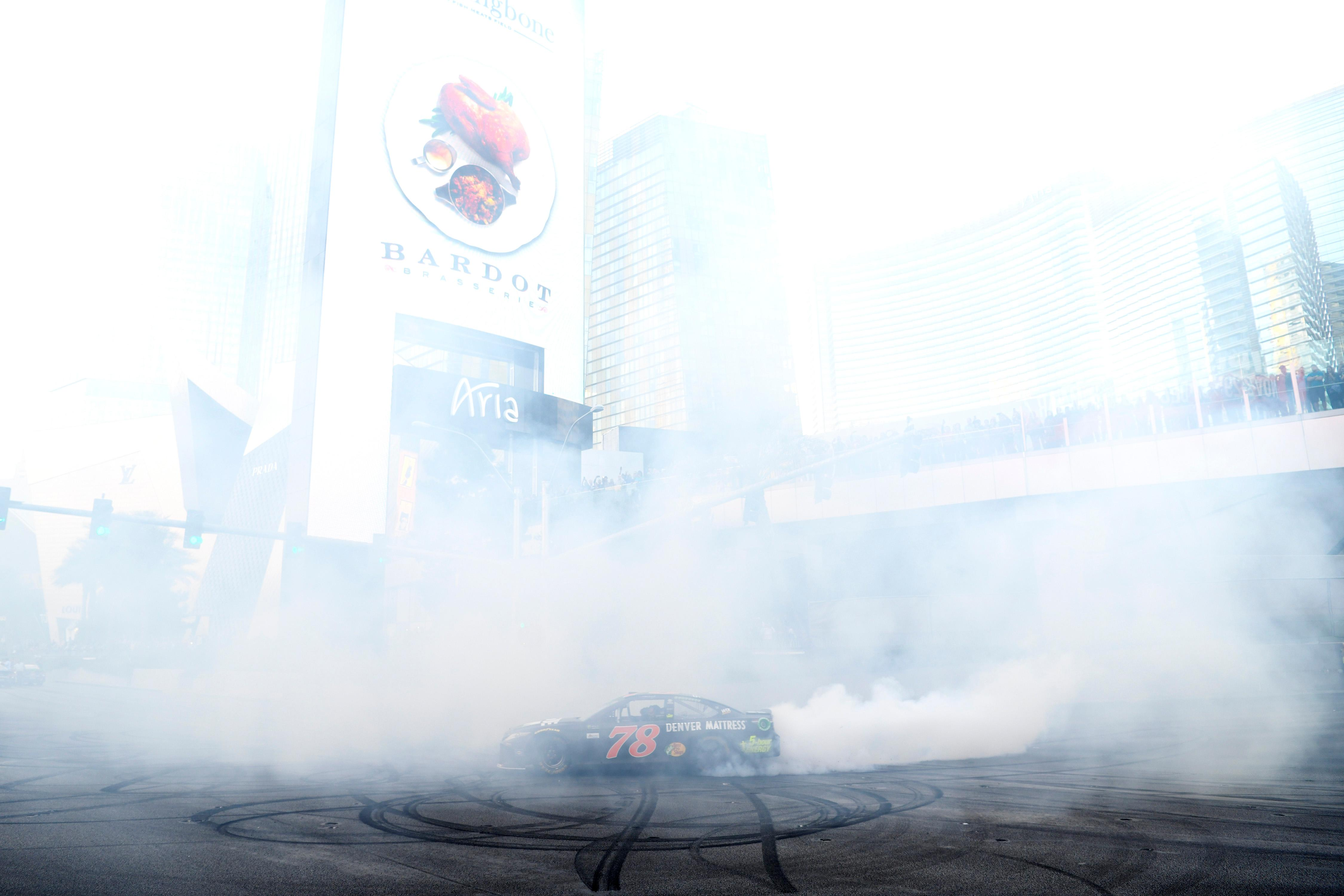 Series champion Martin Truex Jr. does a burnout at the intersection of the Strip and Harmon Avenue during the NASCAR Victory Lap being held as part of Champions Week Wednesday, November 29, 2017. CREDIT: Sam Morris/Las Vegas News Bureau