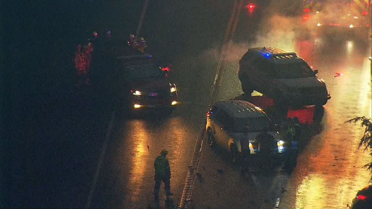 A crash involving a car and semi truck has shut down both directions State Route 18 near Issaquah, Monday, Feb. 5, 2018. (Photo: KOMO/ Air 4)