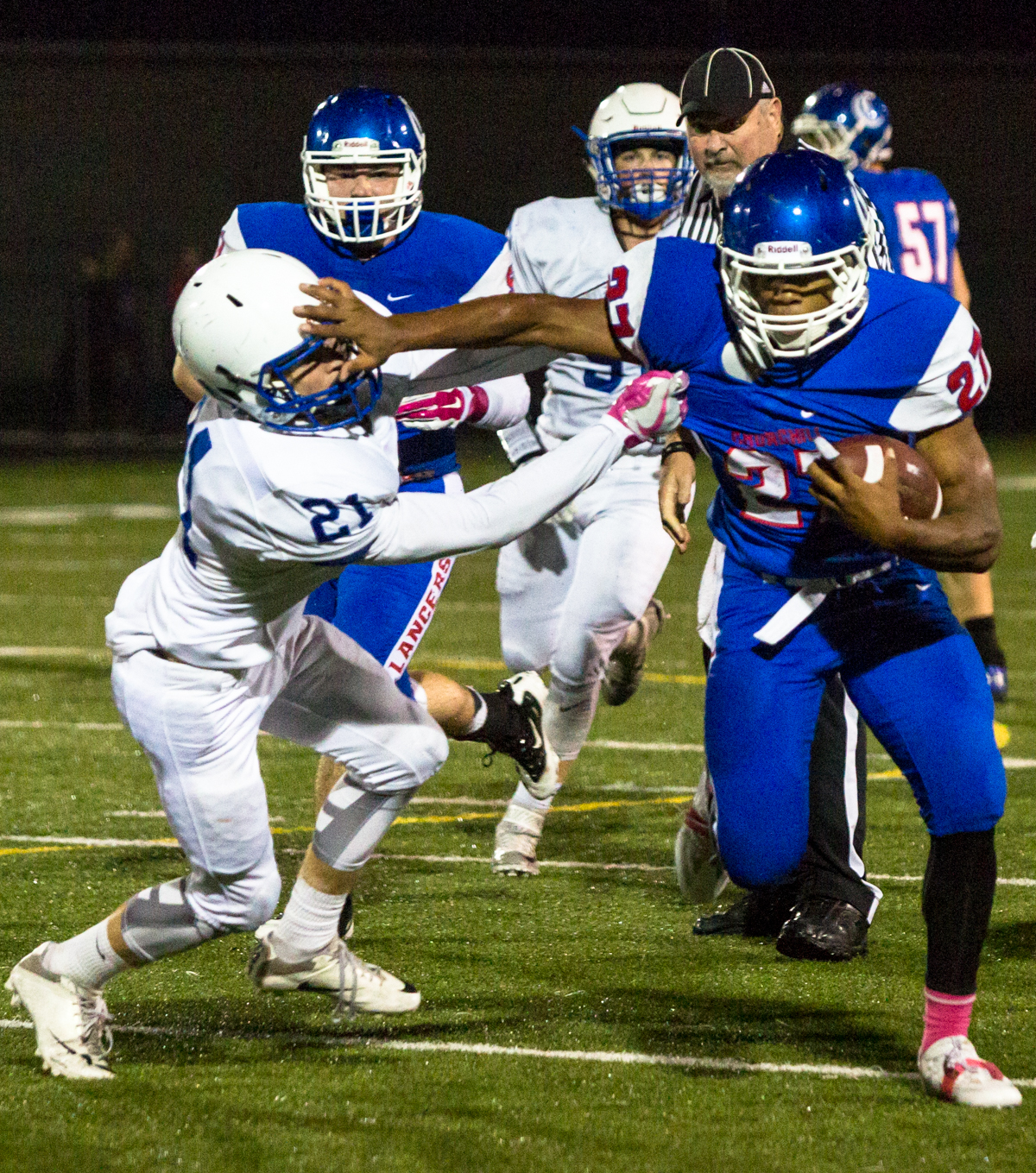 Churchill Lancers running back Sam Jackson (#27) runs past Eagle Point Eagles defensive back Noah Page (#21). Eagle Point defeated Churchill 42-37. Photo by Justin Hartney, Oregon News Lab