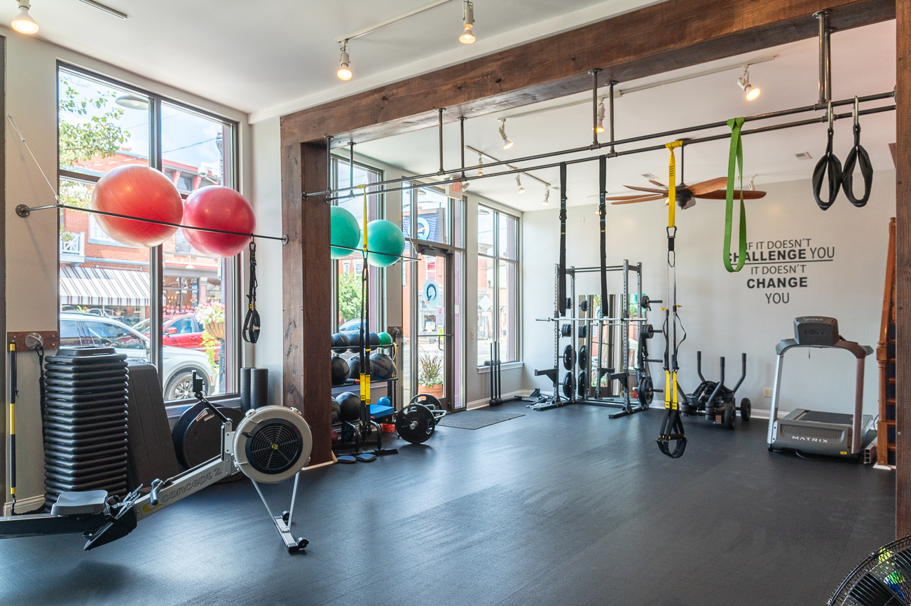 Melissa opened QFit in September 2017. She'd worked for years in big chain gyms to build her clientele before spearheading her own endeavor. She found the space while enjoying the avenue and determined it would be a perfect place to start her studio. / Image: Phil Armstrong, Cincinnati Refined // Published: 9.1.20