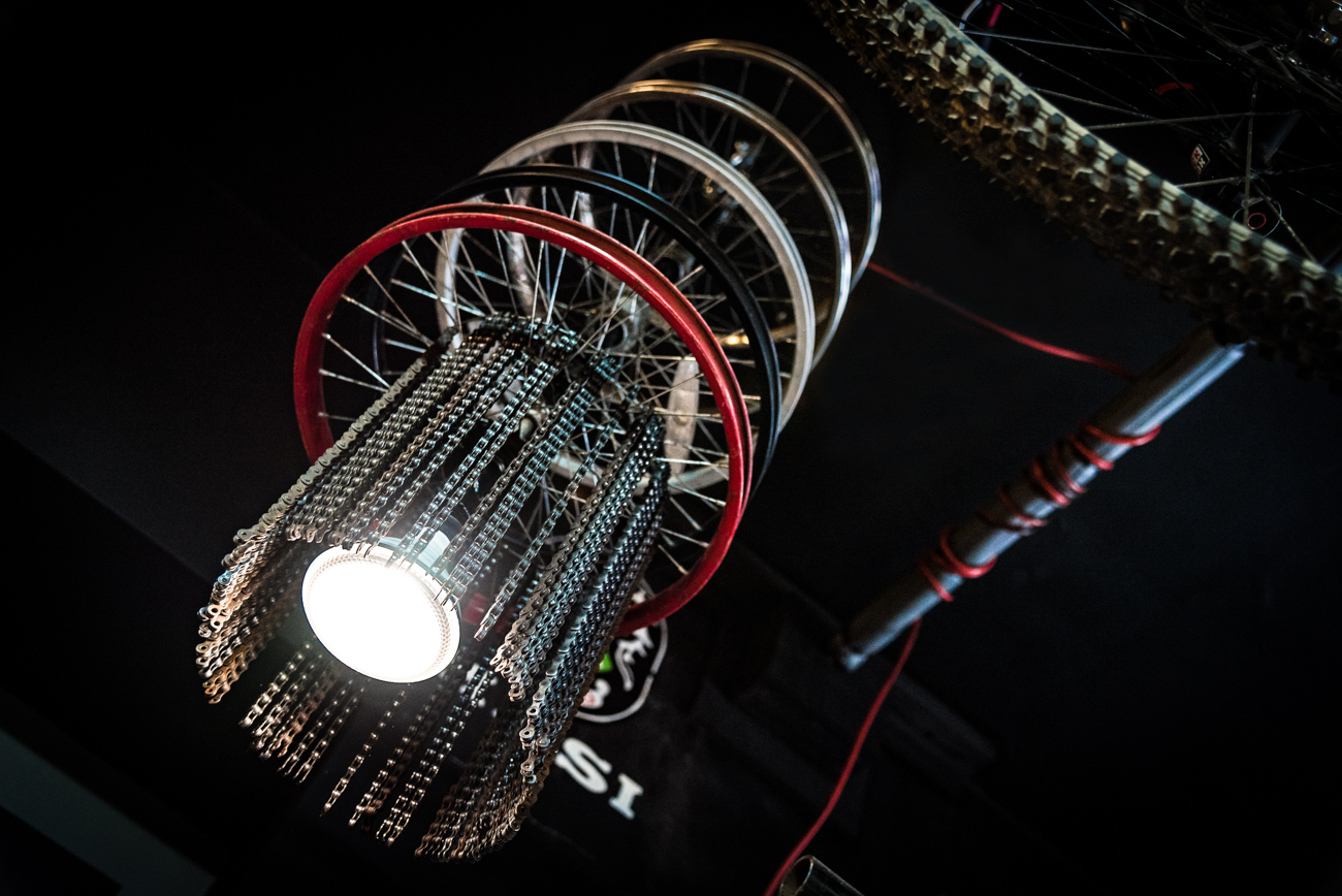 A unique lamp hangs from the ceiling. It is made from wheel frames and stands of bicycle chains. / Image: Phil Armstrong, Cincinnati Refined // Published: 3.19.17