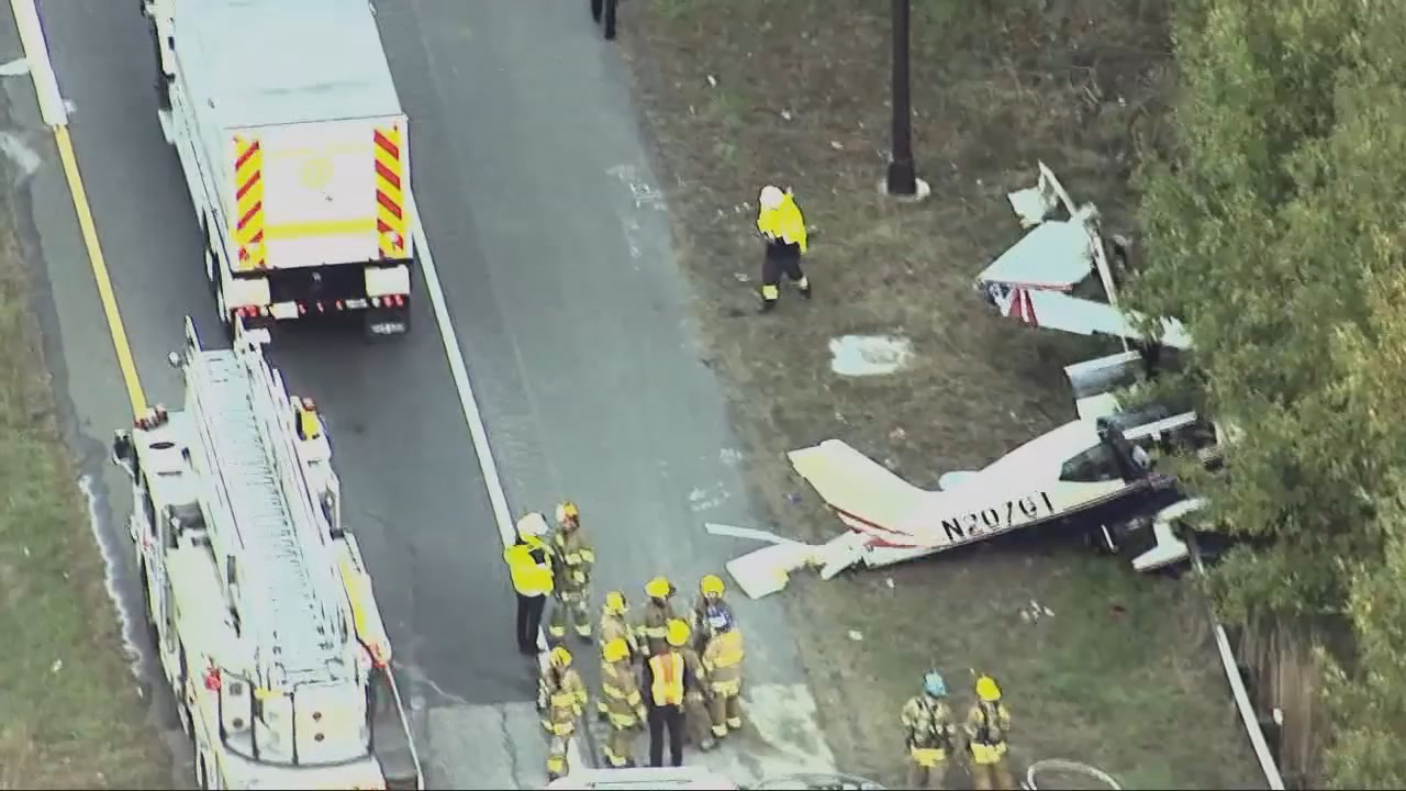 Dad sounds calm as he lands small plane with two sons aboard on Annapolis highway ramp. (ABC7)