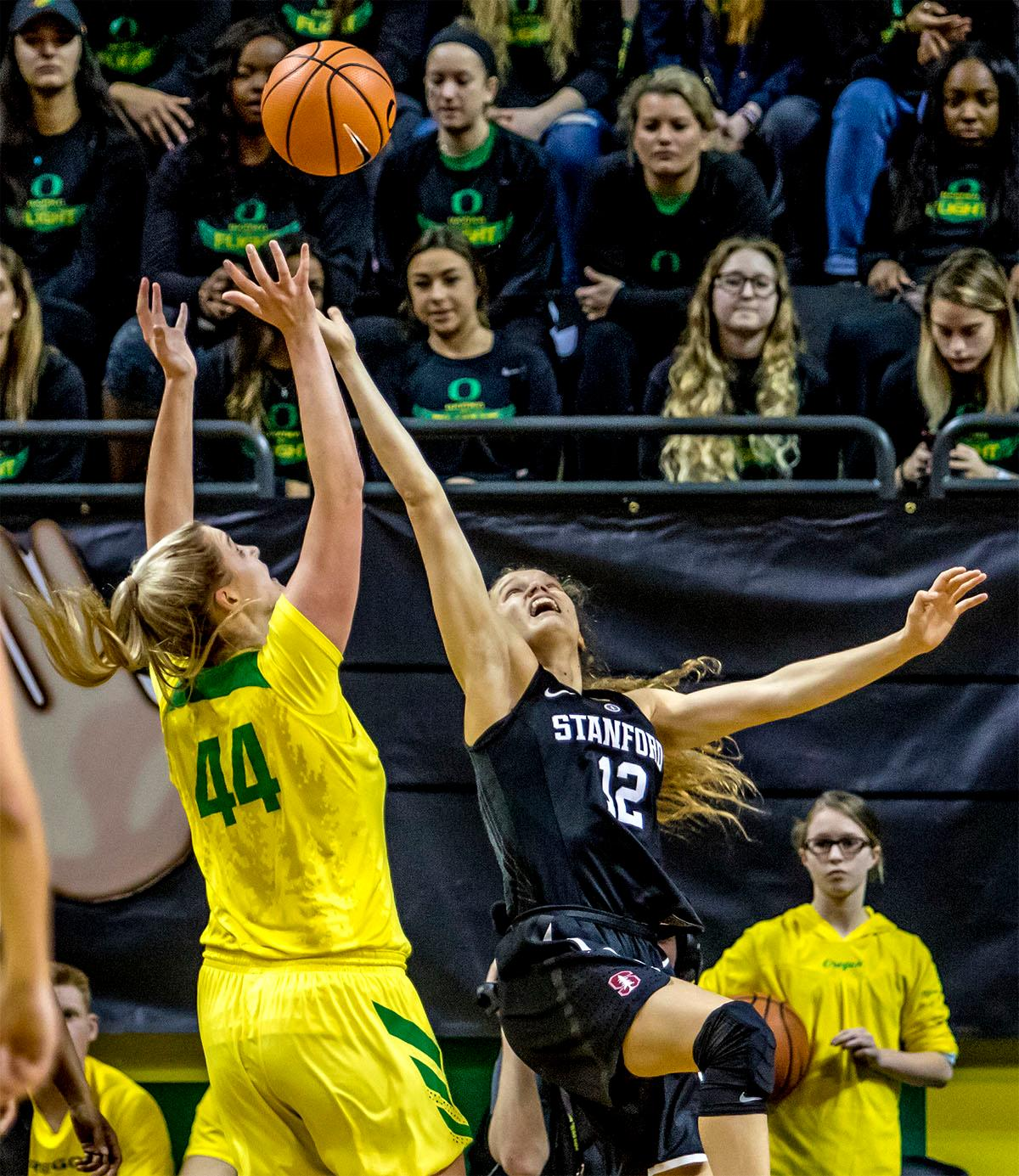The Duck's Mallory McGwire (#44) goes for the rebound against the Cardinal's Brittany McPhee (#12). The Stanford Cardinal defeated the Oregon Ducks 78-65 on Sunday afternoon at Matthew Knight Arena. Stanford is now 10-2 in conference play and with this loss the Ducks drop to 10-2. Leading the Stanford Cardinal was Brittany McPhee with 33 points, Alanna Smith with 14 points, and Kiana Williams with 14 points. For the Ducks Sabrina Ionescu led with 22 points, Ruthy Hebard added 16 points, and Satou Sabally put in 14 points. Photo by August Frank, Oregon News Lab