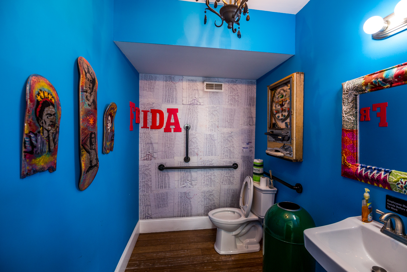 PLACE #1: Frida 602 / ADDRESS: 602 Main Street (41011) / Covington's Frida 602 has a bathroom that's as colorful and vibrant as the rest of the restaurant's decor. The Frida Kahlo-themed bar and restaurant didn't miss a chance to decorate the walls with images of the artist. And the beautiful chandeliers will make you forget you're even in a bathroom. / Image: Catherine Viox // Published: 8.8.19