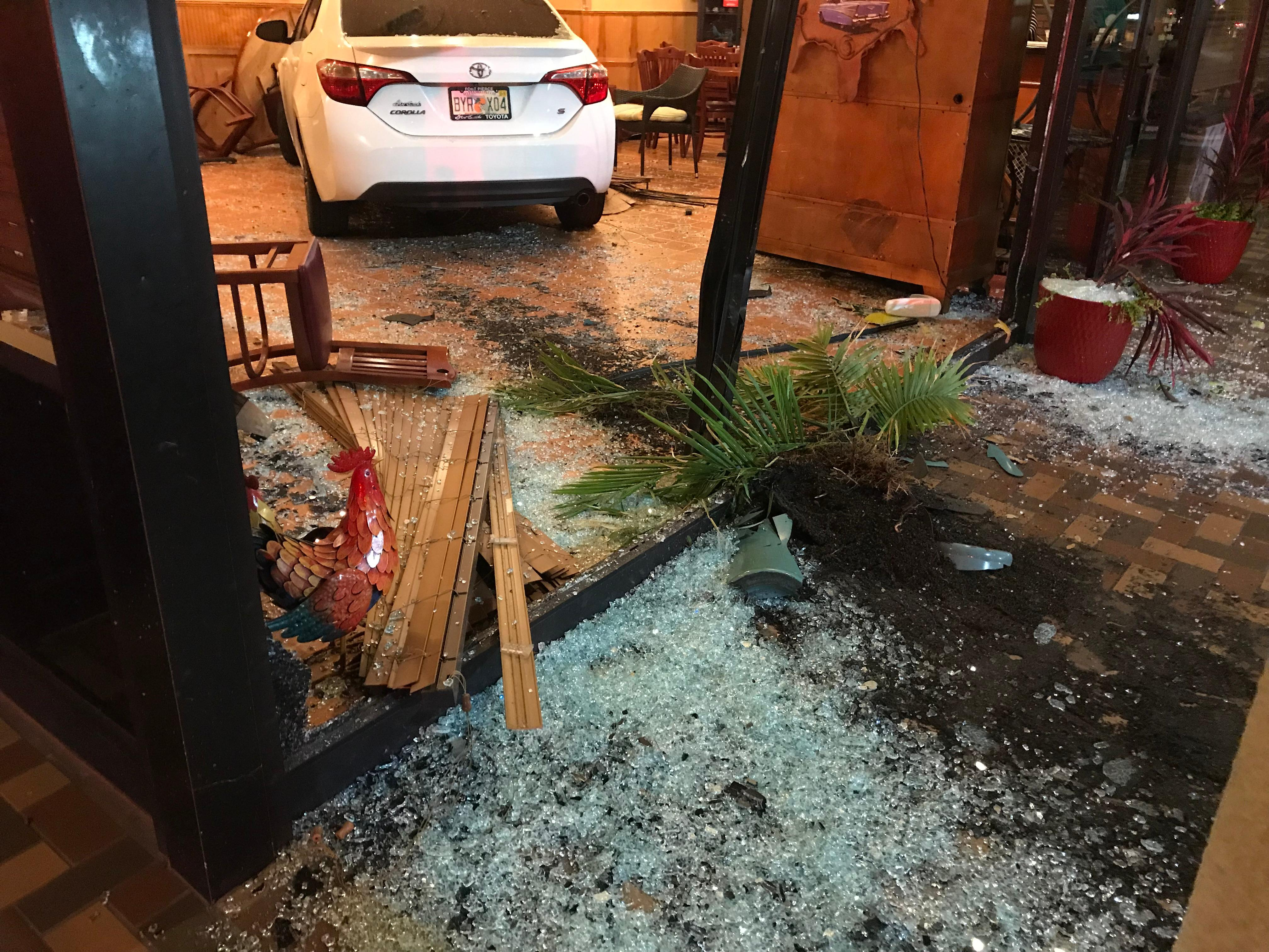 The aftermath of a crash that sent a car completely into a PSL restaurant.