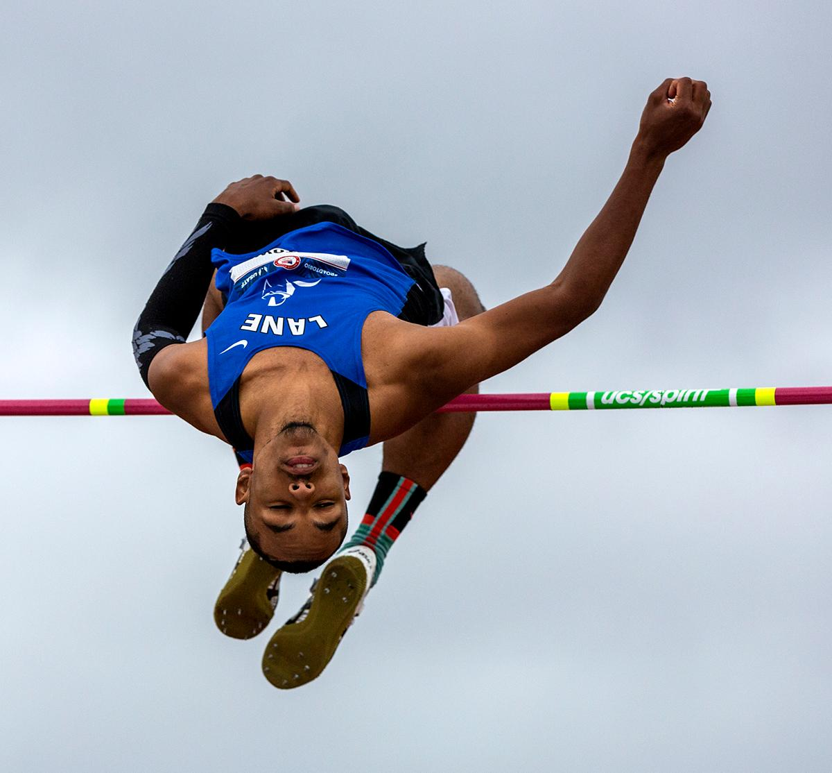 Lane's Darkarai Hightower throws himself over the bar in the high jump. Hightower finished sixth with a final height of 2.21 meters. Photo by August Frank, Oregon News Lab