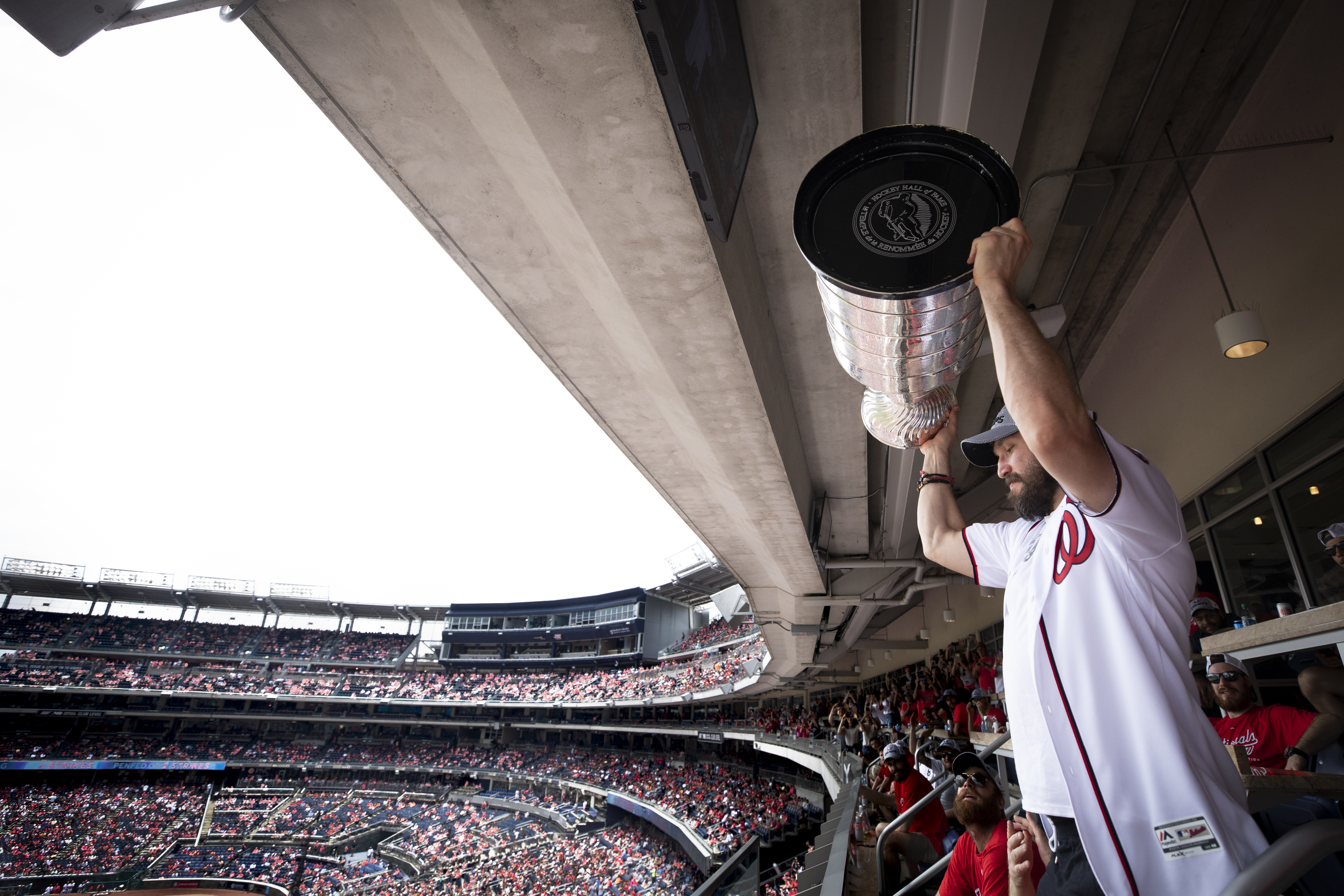 Two days after their Stanley Cup win, Alex Ovechkin and the Capitals brought Lord Stanley to the Nationals home game. To honor the Caps, the Nats asked Ovechkin to throw out the ceremonial first pitch ... twice! After the first attempt sailed over Max Scherzer's head, Ovechkin asked for a redo. The Caps hoisted the Cup up high several times in their suite throughout the game and indulged fan requests for a few photos. The celebrations continued later that day with the Caps diving in the Georgetown waterfront fountain, and Ovechkin doing a Keg Stand with the Cup! (Image: Patrick McDermott for the Washington Capitals)<br>