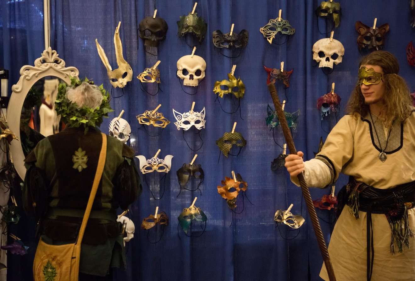 Masks hang on a vendor's wall at Mythicworlds Convention and Masquerades. (Sy Bean / Seattle Refined)