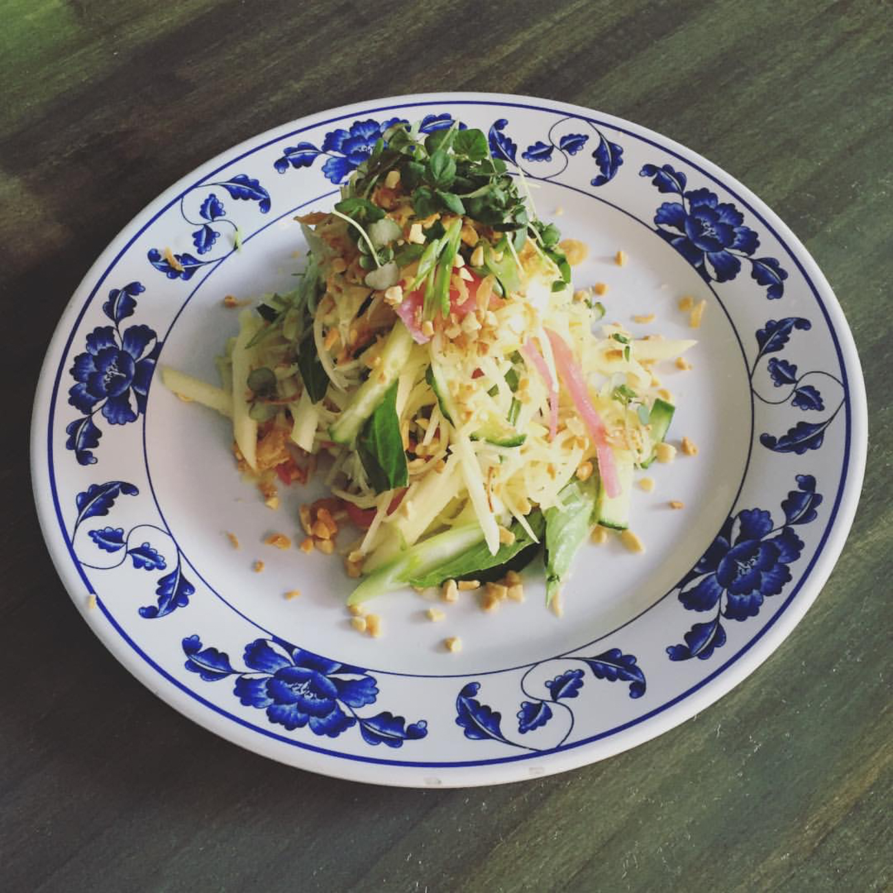 Papaya Salad: green apple, pickled red onions, onions, peanuts, fried shallots, herbs, and nuoc mam / Image courtesy of Quan Hapa // Published: 1.10.17