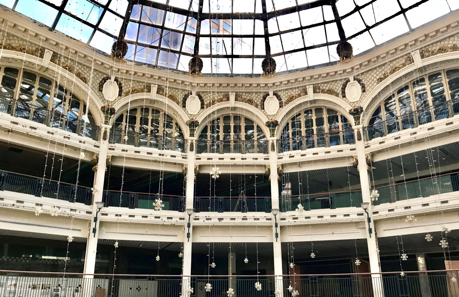 "Completed in 1904, many people describe the Dayton Arcade, a series of five interconnected buildings by a glass rotunda, as ""the most emotional building in Dayton."" It's empty now, but in its heyday, it was the site of a bustling urban mall. Now, private developers are restoring the buildings, with the intent to bring this beautiful structure back to life. Dayton Arcade is located about 55 miles north of Cincinnati. / Image: Brian Planalp // Published: 6.4.17"