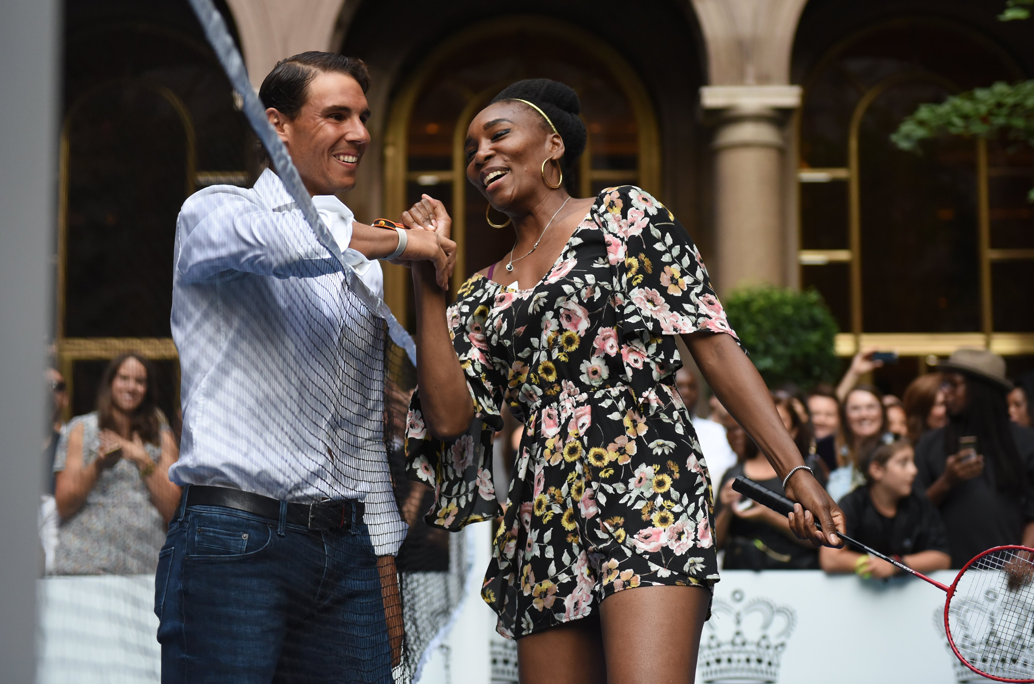 Venus Williams of the USA jokes with world number one tennis player Rafael Nadal of Spain as they participate in the Lotte New York Palace Invitational Badminton Tournament at the Lotte New York Palace in New York August 24, 2017. / AFP PHOTO / TIMOTHY A. CLARY        (Photo credit should read TIMOTHY A. CLARY/AFP/Getty Images)