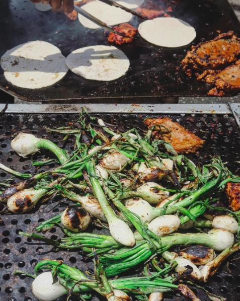 IMAGE: IG user @twohungrybrits / POST: Whole spring onions charring up on the grill... So simple yet it will always remind me of walking around Mexican food markets! #hungryformexico