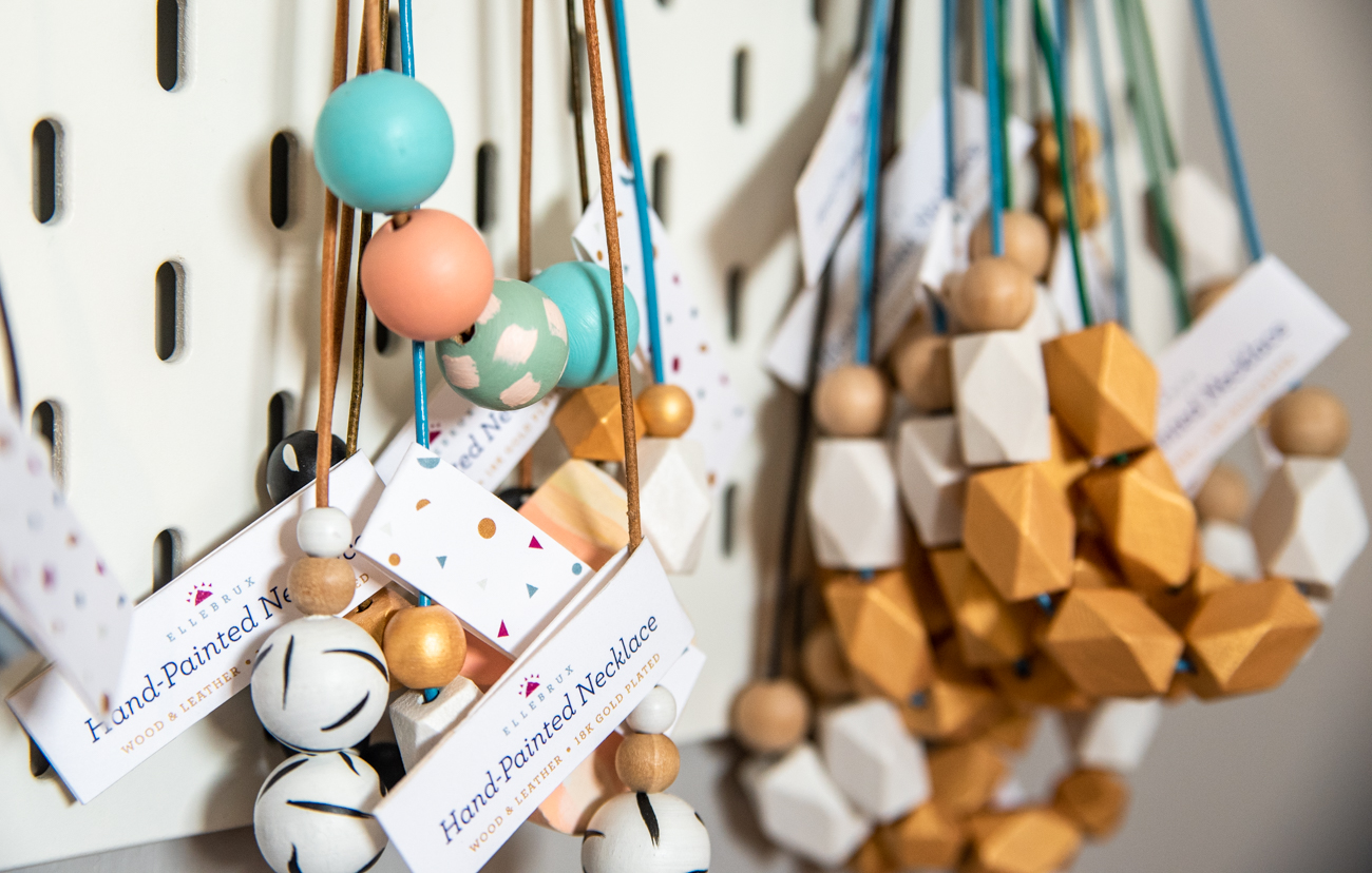 The necklaces feature hand-painted wooden beads in a variety of shapes and colors. / Image: Melissa Sliney // Published: 3.26.20