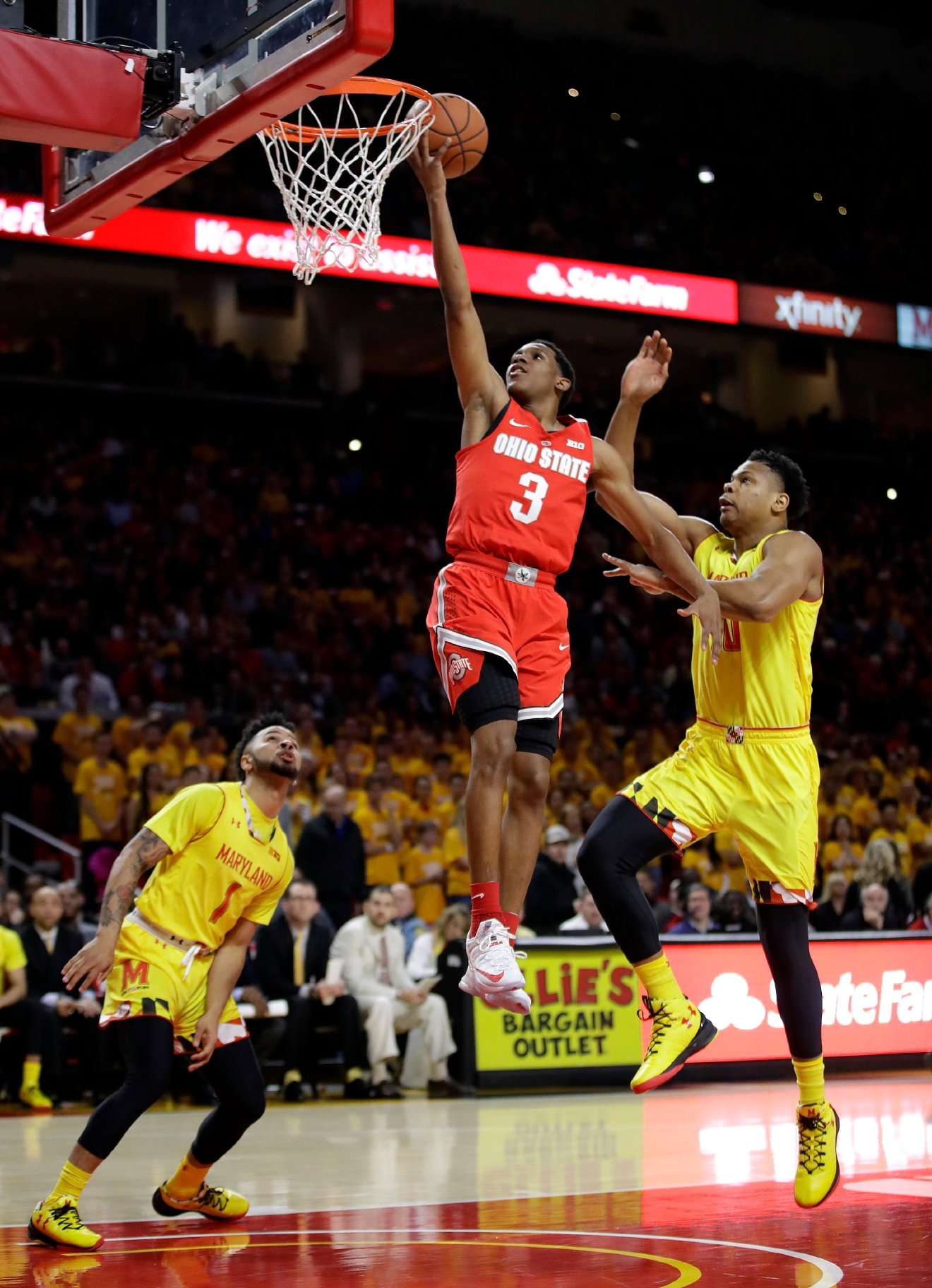 Ohio State guard C.J. Jackson (3) shoots over Maryland guard Jaylen Brantley, bottom left, and forward L.G. Gill in the first half of an NCAA college basketball game, Saturday, Feb. 11, 2017, in College Park, Md. (AP Photo/Patrick Semansky)