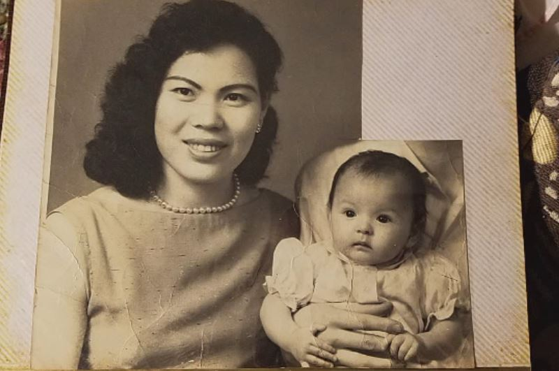 Sandy Lung was born in Taiwan.  She is now 60, living in Hawaii.  She's spent the last 50 years searching for her father.{&amp;nbsp;} This is a photo taken in 1957 of her mother, herself, and her father is cut out.{&amp;nbsp;} She's spent almost her whole life finding that missing piece of her life (Liz Cooper/WPDE)<p></p>