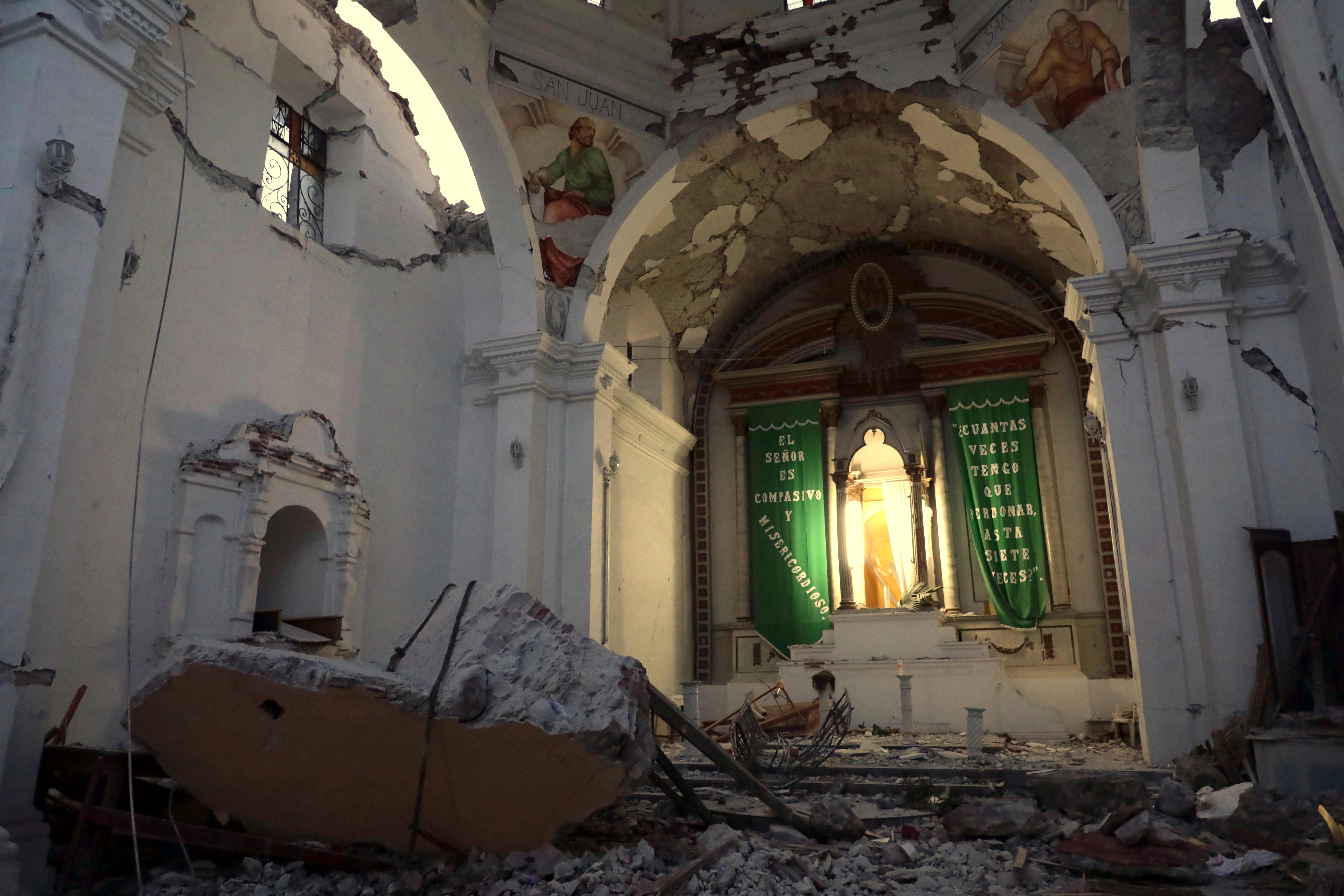 The sky is exposed from inside Santiago Apostol church which collapsed during the 7.1 earthquake in the town of Atzala in Puebla state, Mexico, Wednesday, Sept. 20, 2017. According to family members of the 11 people who died inside the church during Tuesday's quake, the roof collapsed during a Mass held to baptize a two-year-old girl, and the only people who survived were the baby's father, the priest and the priest's assistant. (AP Photo/Pablo Spencer)