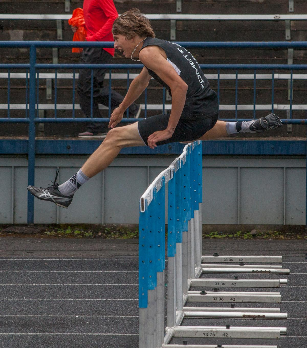 Cal Duke from Crater High School wins the Men's 110m Hurdles event with the time of 15.61 at the 5A-3 Midwestern League District Track Championship. Photo by Vannie Cooper, Oregon News Lab