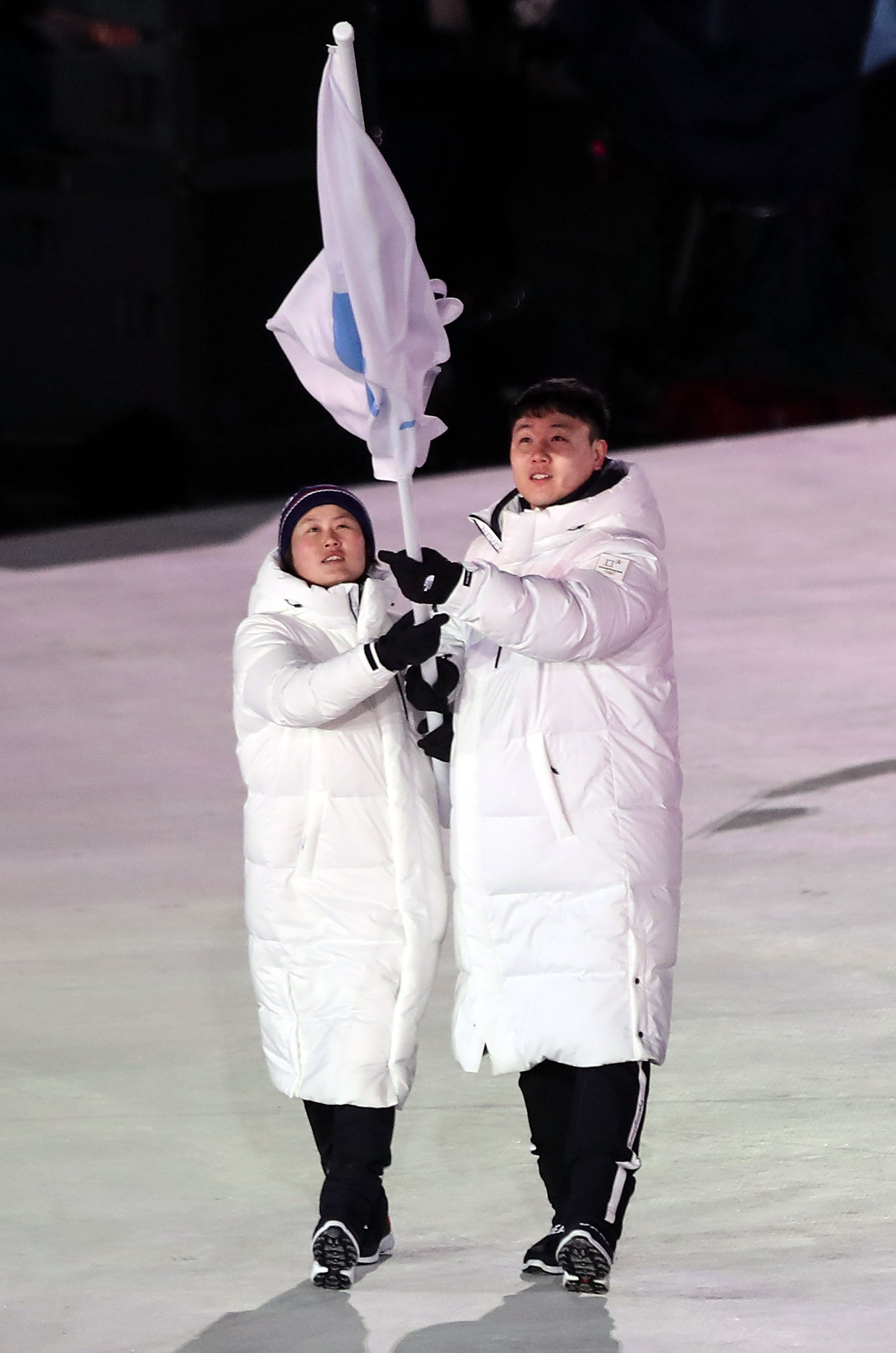 PYEONGCHANG-GUN, SOUTH KOREA - FEBRUARY 09:  Flag bearers Chung Guam Hwang and Yunjong Won of Republic of Korea leads the team during the Opening Ceremony of the PyeongChang 2018 Winter Olympic Games at PyeongChang Olympic Stadium on February 9, 2018 in Pyeongchang-gun, South Korea.  fee liable image, copyright © ATP  Amin JAMALI  XXIII. OLYMPIC WINTER GAMES PYEONGCHANG 2018: OPENING CEREMONY,  PyeongChang, Korea, Winter Olympics; PyeongChang Olympic Stadium, on 9. February 2018, fee liable image, copyright © ATP / Amin JAMALI  Featuring: Flag bearers Chung Guam Hwang and Yunjong Won of Republic of Korea Where: Pyeongchang, Gangwon Province, South Korea When: 09 Feb 2018 Credit: ATP/WENN.com  **Not available for publication in Germany or France. No Contact Music.**