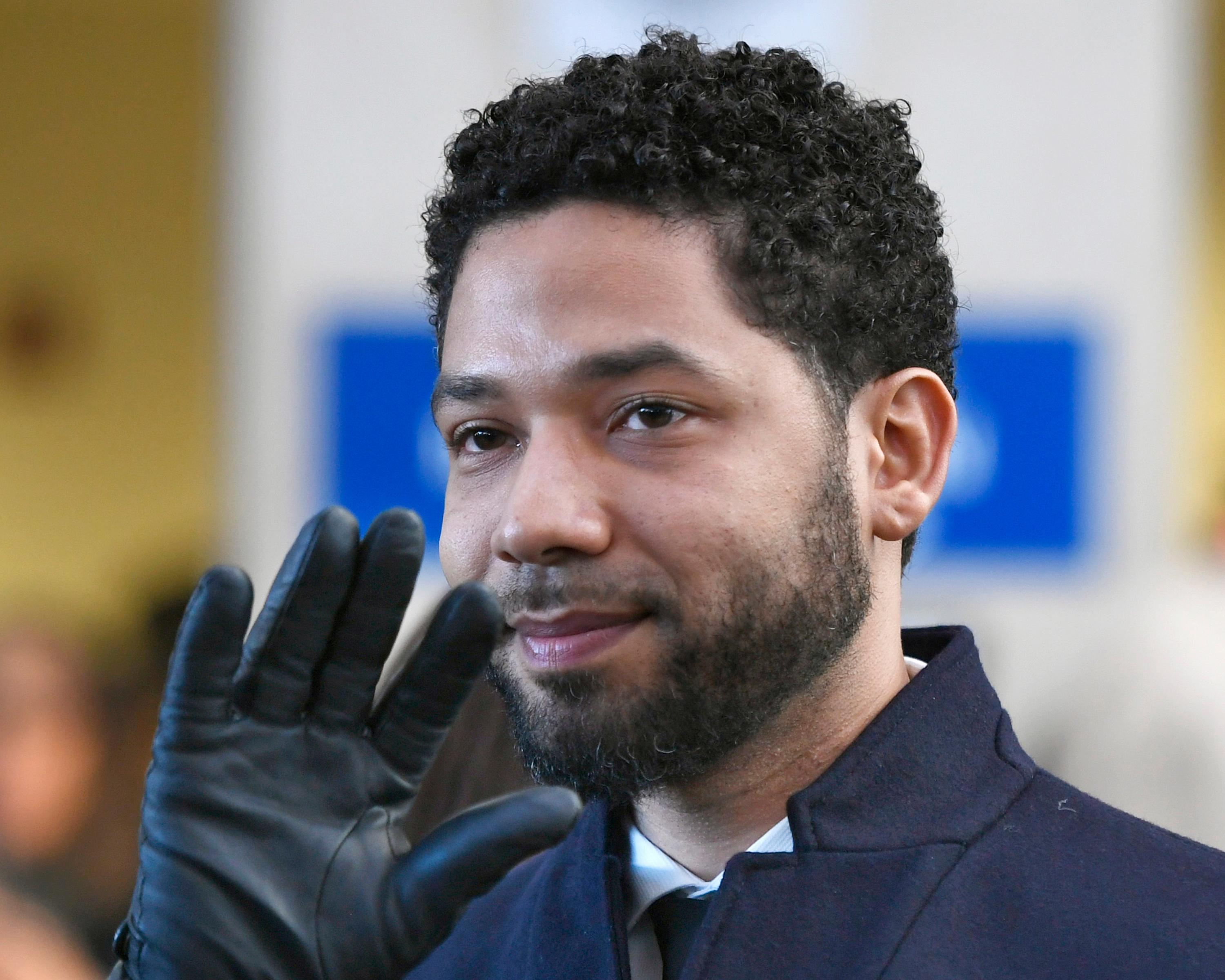 "FILE - In this March 26, 2019, file photo, actor Jussie Smollett smiles and waves to supporters before leaving Cook County Court after his charges were dropped in Chicago. Text messages show the Chicago prosecutor whose office handled the case of ""Empire"" actor Jussie Smollett told her top deputy that Smollett was a ""washed up celeb"" who was overcharged. The office of Cook County State's Attorney Kim Foxx released thousands of documents from the investigation late Tuesday, April 16, 2019, in response to media requests. (AP Photo/Paul Beaty, File)"