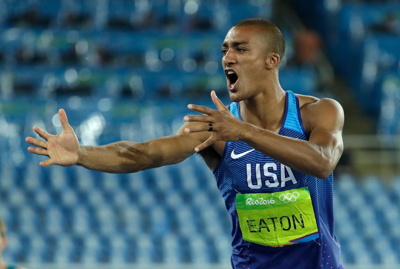 United States' Ashton Eaton celebrates after an attempt in the high jump of the decathlon during the athletics competitions of the 2016 Summer Olympics at the Olympic stadium in Rio de Janeiro, Brazil, Wednesday, Aug. 17, 2016. (AP Photo/Matt Slocum)