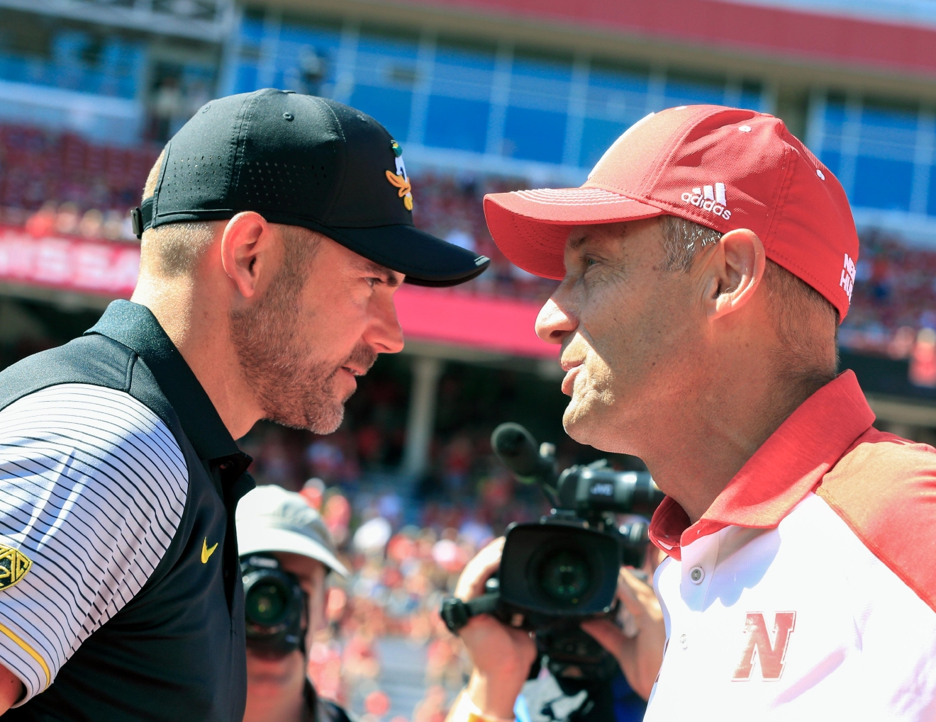 Oregon head coach Mark Helfrich, left, and Nebraska head coach Mike Riley meet before an NCAA college football game in Lincoln, Neb., Saturday, Sept. 17, 2016. (AP Photo/Nati Harnik)