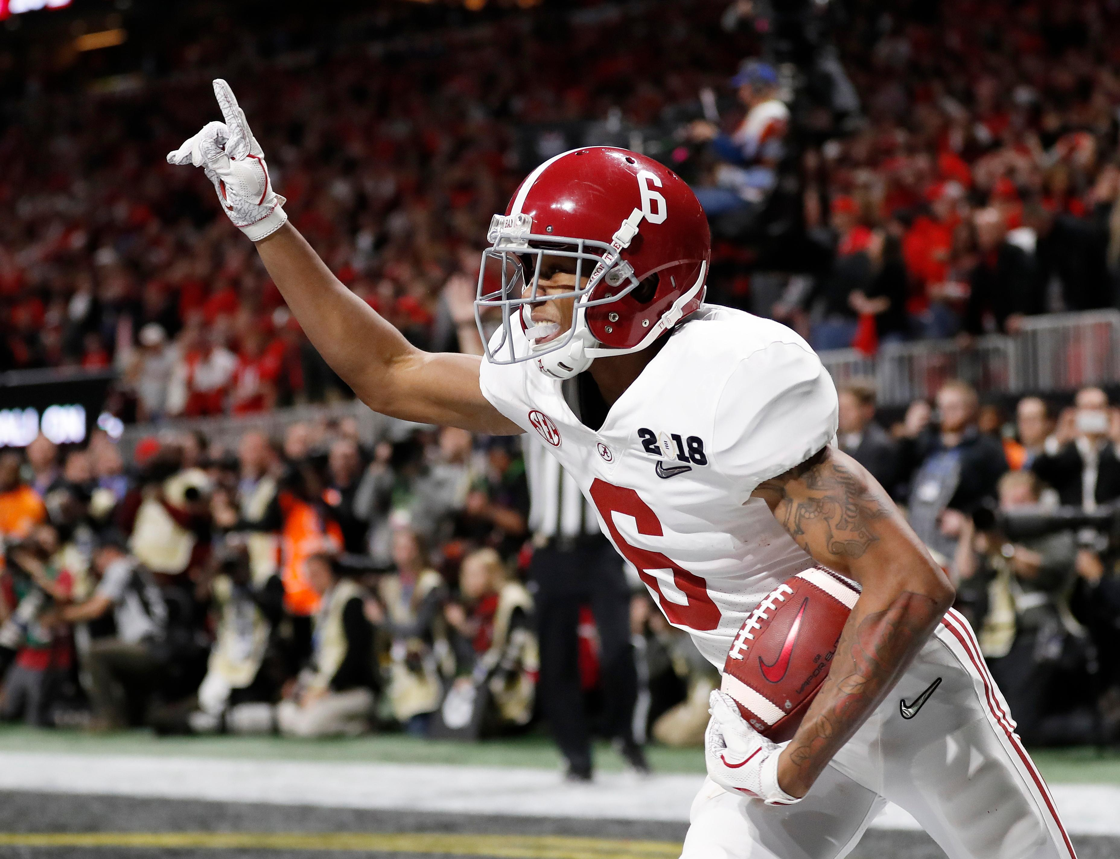Alabama wide receiver DeVonta Smith (6) celebrates his touchdown during overtime of the NCAA college football playoff championship game against Georgia, Monday, Jan. 8, 2018, in Atlanta. Alabama won 26-23 in overtime. (AP Photo/David Goldman)