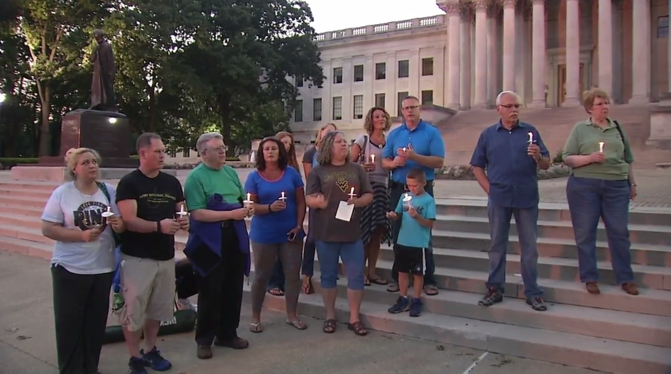People came to the West Virginia Capitol on Saturday, June 25, 2016 for a vigil to remember flood victims. One of the victims people paid tribute to was Joni Adams, who was an avid runner and served as a longtime teacher at South Charleston Middle School.  (WCHS/WVAH)