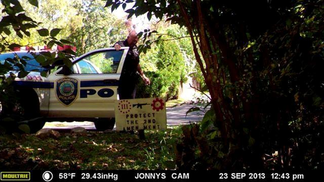 So he set up a hunting field camera and caught an unlikely culpirt: a police officer.