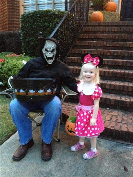 Minnie Mouse gets some candy from a friendly ghoul!