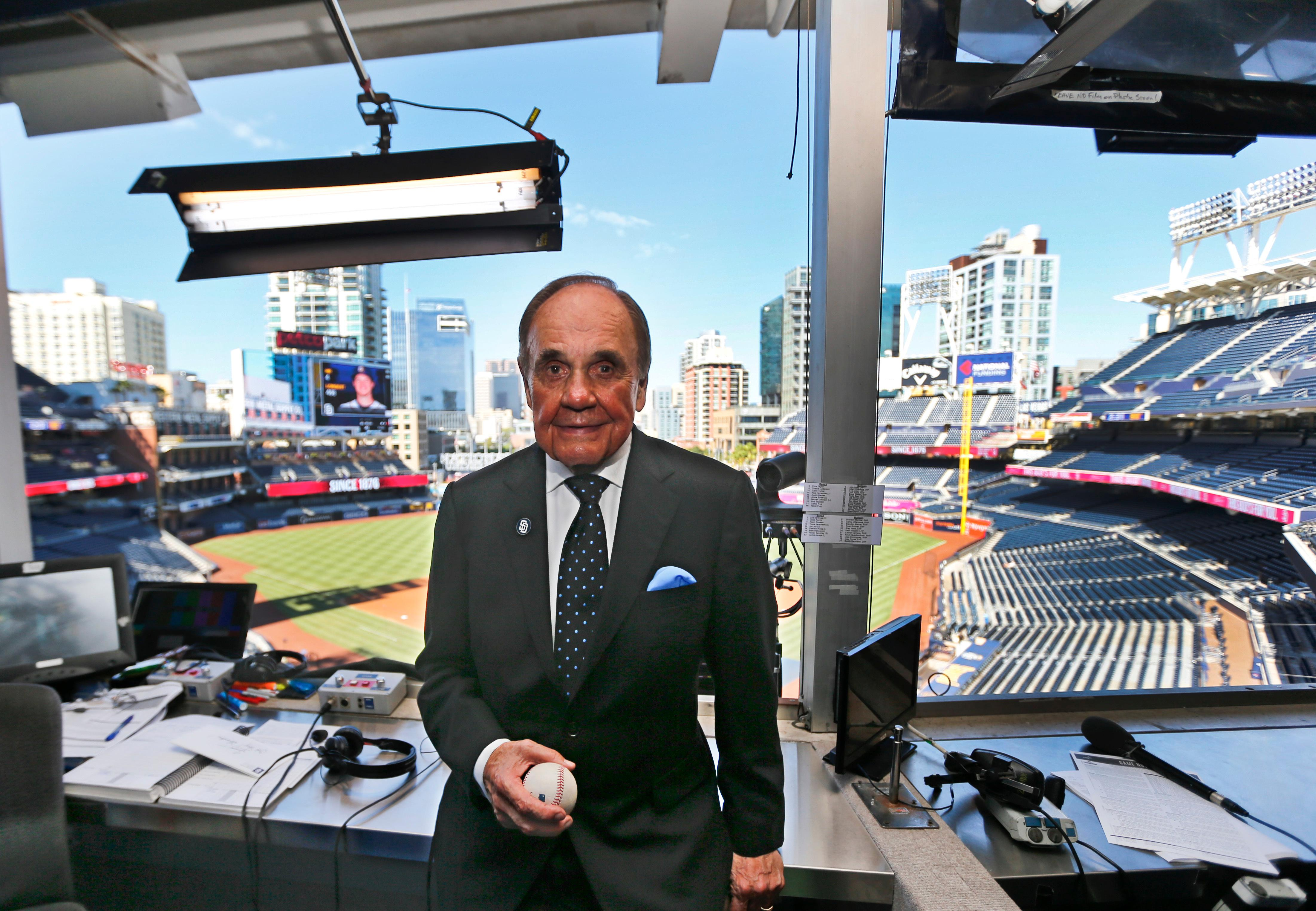 FILE - In this Sept. 29, 2016, file photo, Dick Enberg, the voice of the San Diego Padres, poses in his booth prior to the Padres' final home baseball game of the season in San Diego. Enberg, the sportscaster who got his big break with UCLA basketball and went on to call Super Bowls, Olympics, Final Fours and Angels and Padres baseball games, died Thursday, Dec. 21, 2017. He was 82. Engberg's daughter, Nicole, confirmed the death to The Associated Press. She said the family became concerned when he didn't arrive on his flight to Boston on Thursday, and that he was found dead at his home in La Jolla, a San Diego neighborhood. (AP Photo/Lenny Ignelzi, File)