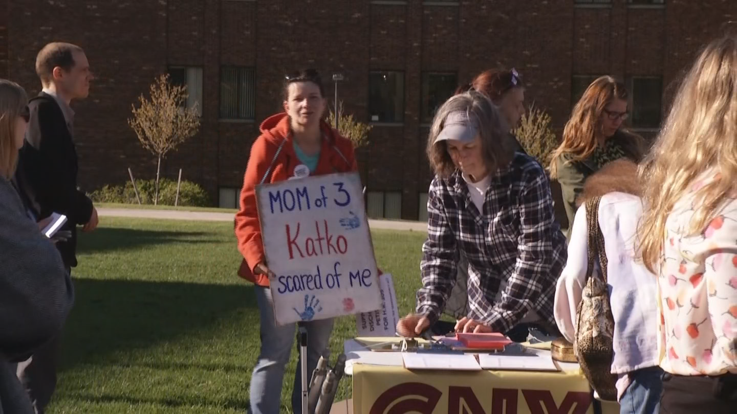 Protesters gather outside OCC for Rep. Katko Town Hall event