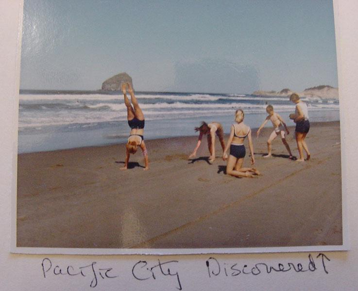 "The Straub daughters (Jane, Patty, and Peg) and son Billy cartwheel and play together with mother Pat on the beach near Pacific City. The caption in the scrapbook reads ""Pacific City Discovered."" This photograph was taken on the same day as the Mother's Day rally and hike in 1966. (Western Oregon University Archives - Robert W. Straub Collection/Used with permission)"