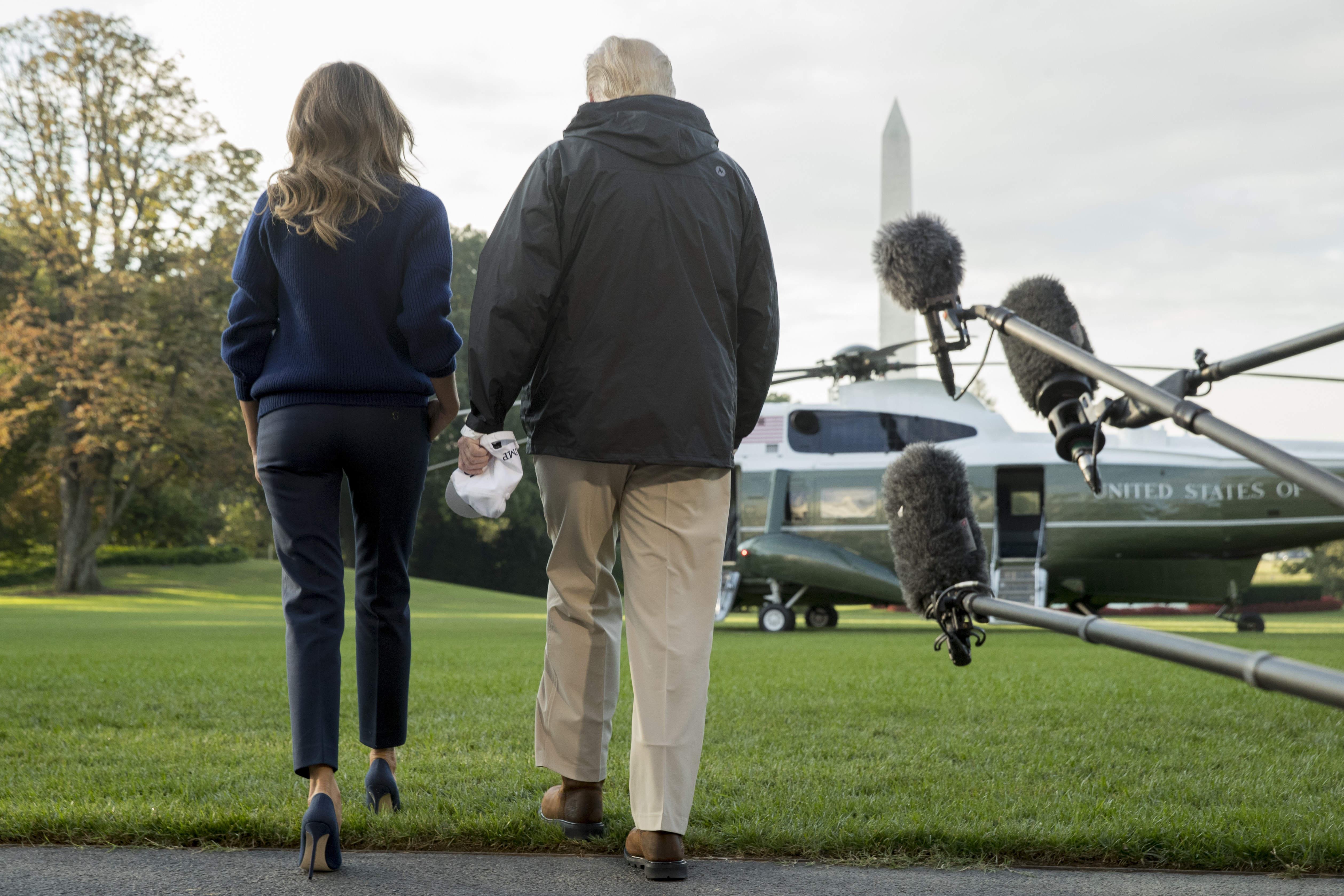 President Donald Trump and first lady Melania Trump walk to board Marine One on the South Lawn of the White House in Washington, Tuesday, Oct. 3, 2017, for a short trip to Andrews Air Force Base, Md. and then on to Puerto Rico. (AP Photo/Andrew Harnik)