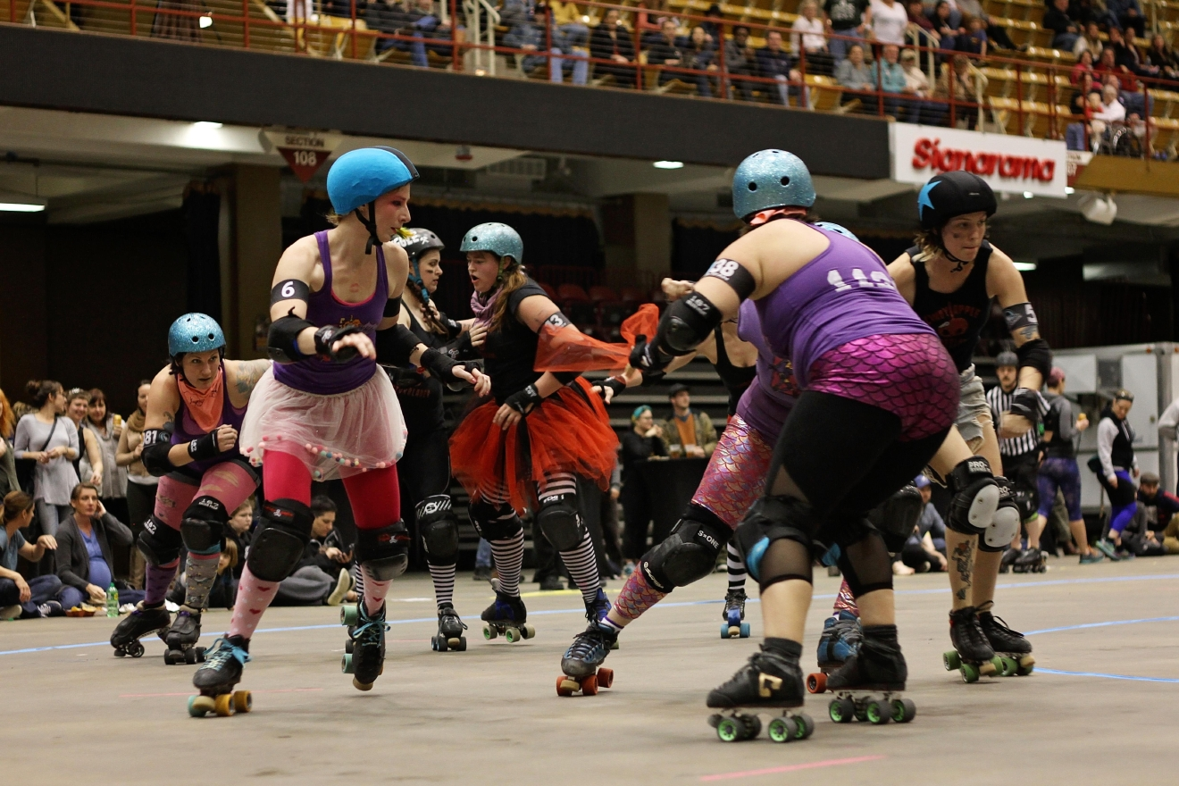 "The Blue Ridge Rollergirls' season opening bout on Feb. 19, 2017 at the US Cellular Center in Asheville.  The Rollergirls were divided into ""throw-back"" teams and compete against one another:  The ""Wham Bam, Thank You Ma'ams"" versus the ""Candy Apple Razor Blades.""  ""Wham Bam, Thank You Ma'ams"" won this meet.  (Photo credit: WLOS Staff)"