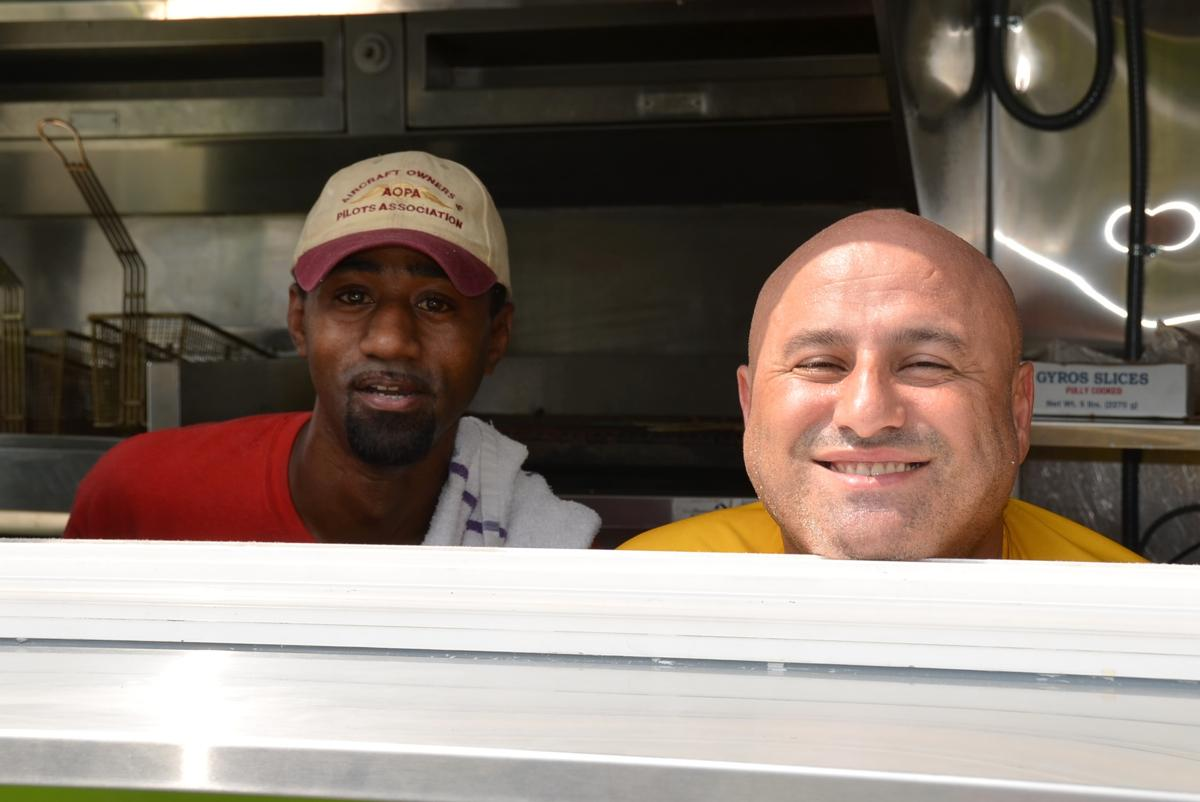 Andy (right) from Andy's Mediterranean Grille reppin' the food truck on 14th St. at the Taste of OTR (Image: Leah Zipperstein / Cincinnati Refined)