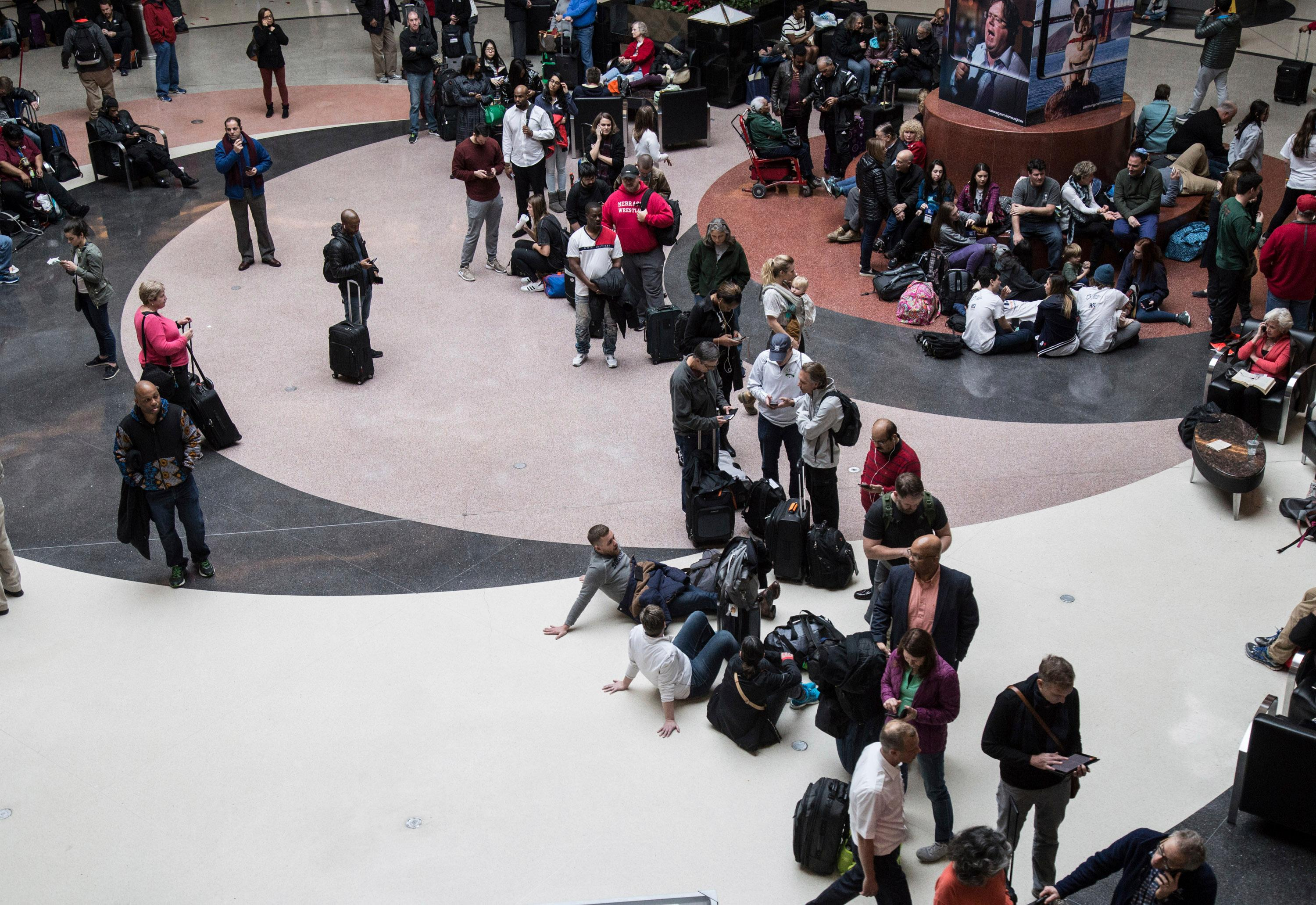 Long lines form at Hartsfield-Jackson International Airport after a power outage, Sunday, Dec. 17, 2017, in Atlanta. A sudden power outage at the Hartsfield-Jackson Atlanta International Airport on Sunday grounded scores of flights and passengers during one of the busiest travel times of the year. (Steve Schaefer/Atlanta Journal-Constitution via AP)