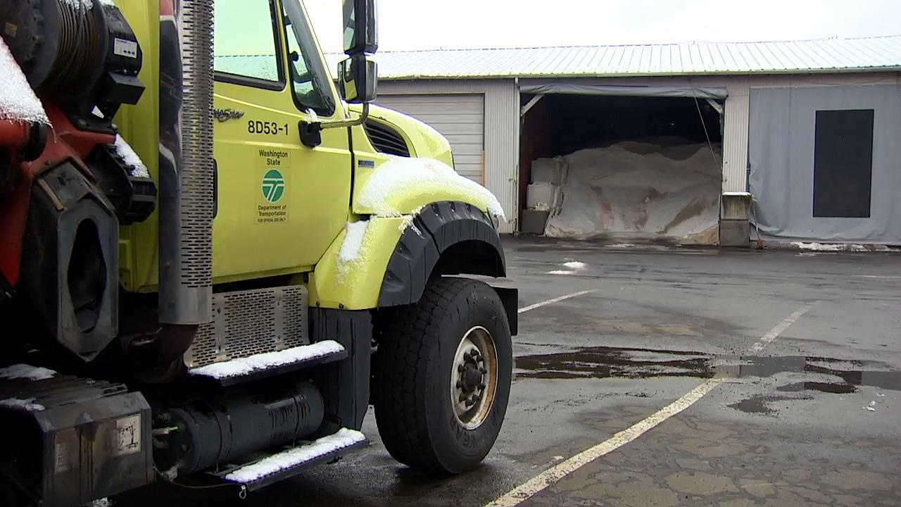 A Washington Department of Transportation truck and a big pile of salt Tuesday used to keep roads in the state clear of ice and snow. (KATU Photo)