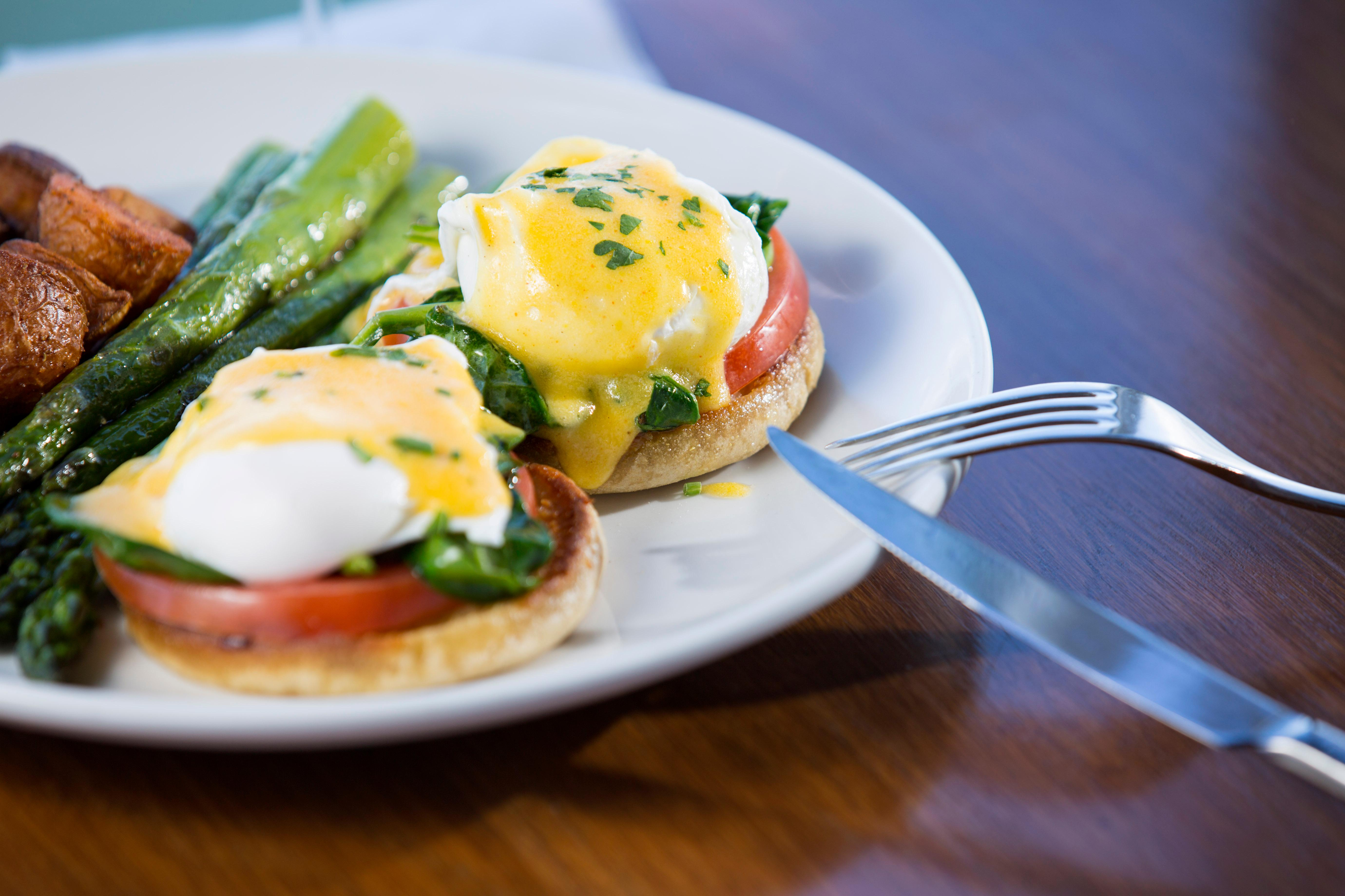 The Florentine Benedict, made with poached eggs, spinach, tomato, on english muffins, covered in hollandaise, and served with a side of asparagus and Old Bay breakfast potatoes. There is also an option to add dungeness crab to your meal. Ray's Boathouse launched its first ongoing weekend brunch for the first time in its 44-year history, and guests can now enjoy Ray's beautiful setting over brunch each weekend. (Sy Bean / Seattle Refined)