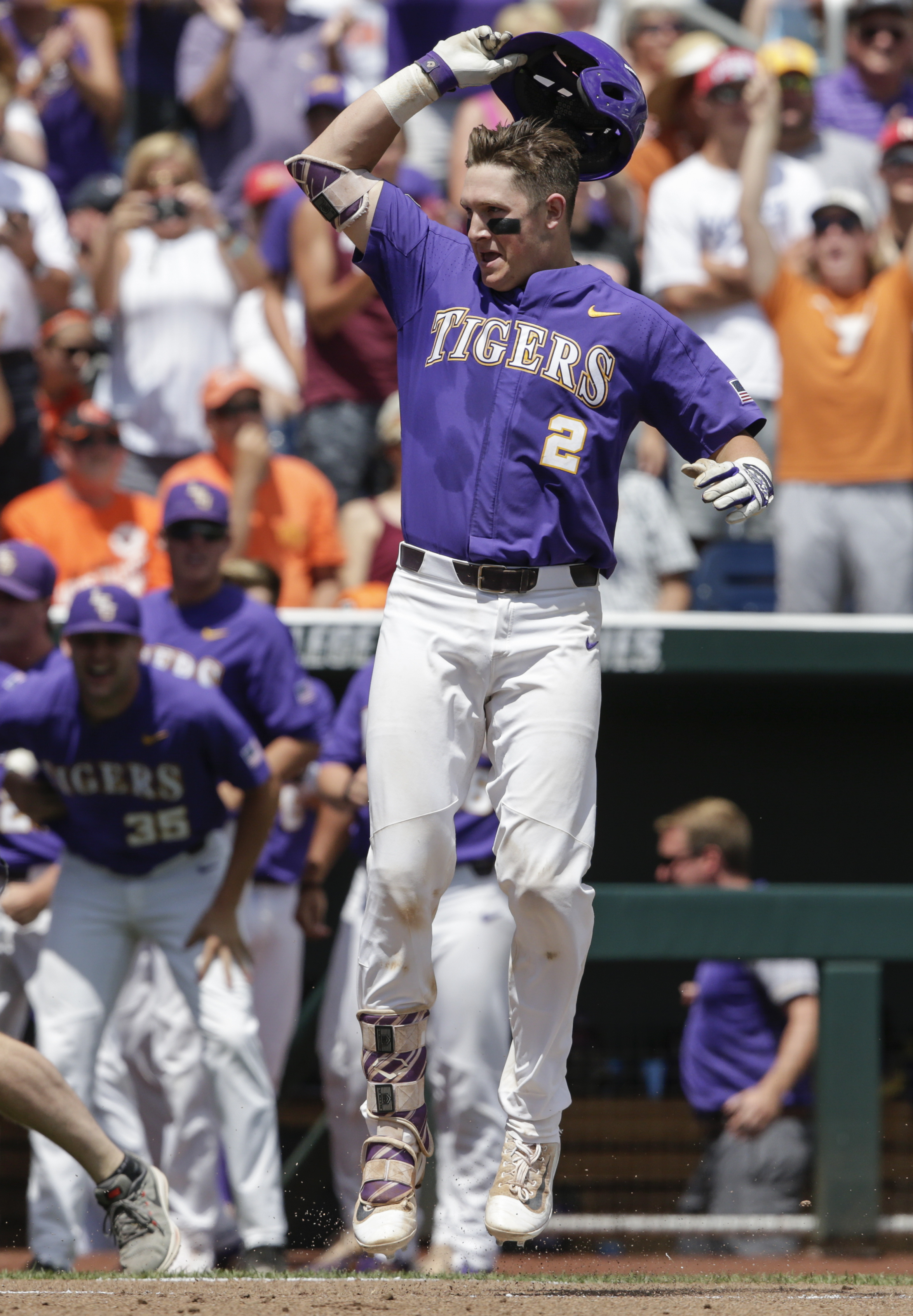 LSU's Michael Papierski (2) celebrates after scoring on his three-run home run against Oregon State in the third inning of an NCAA College World Series baseball elimination game in Omaha, Neb., Saturday, June 24, 2017. (AP Photo/Nati Harnik)