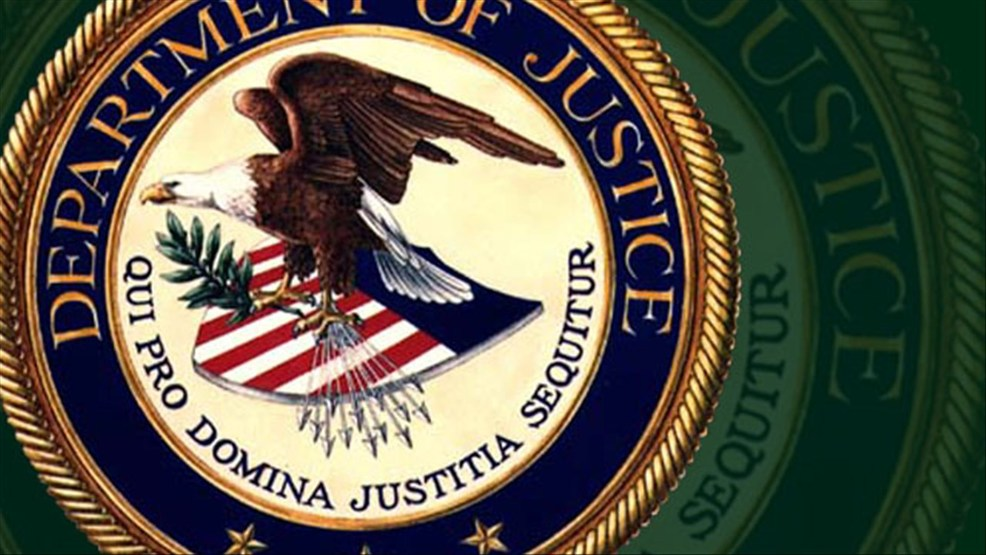 department of justice logo over bg (MGN).jpg