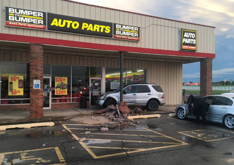 Police say a woman was allegedly trying to steal out of an Auto Parts store when two officers tried to stop her. (KTUL)