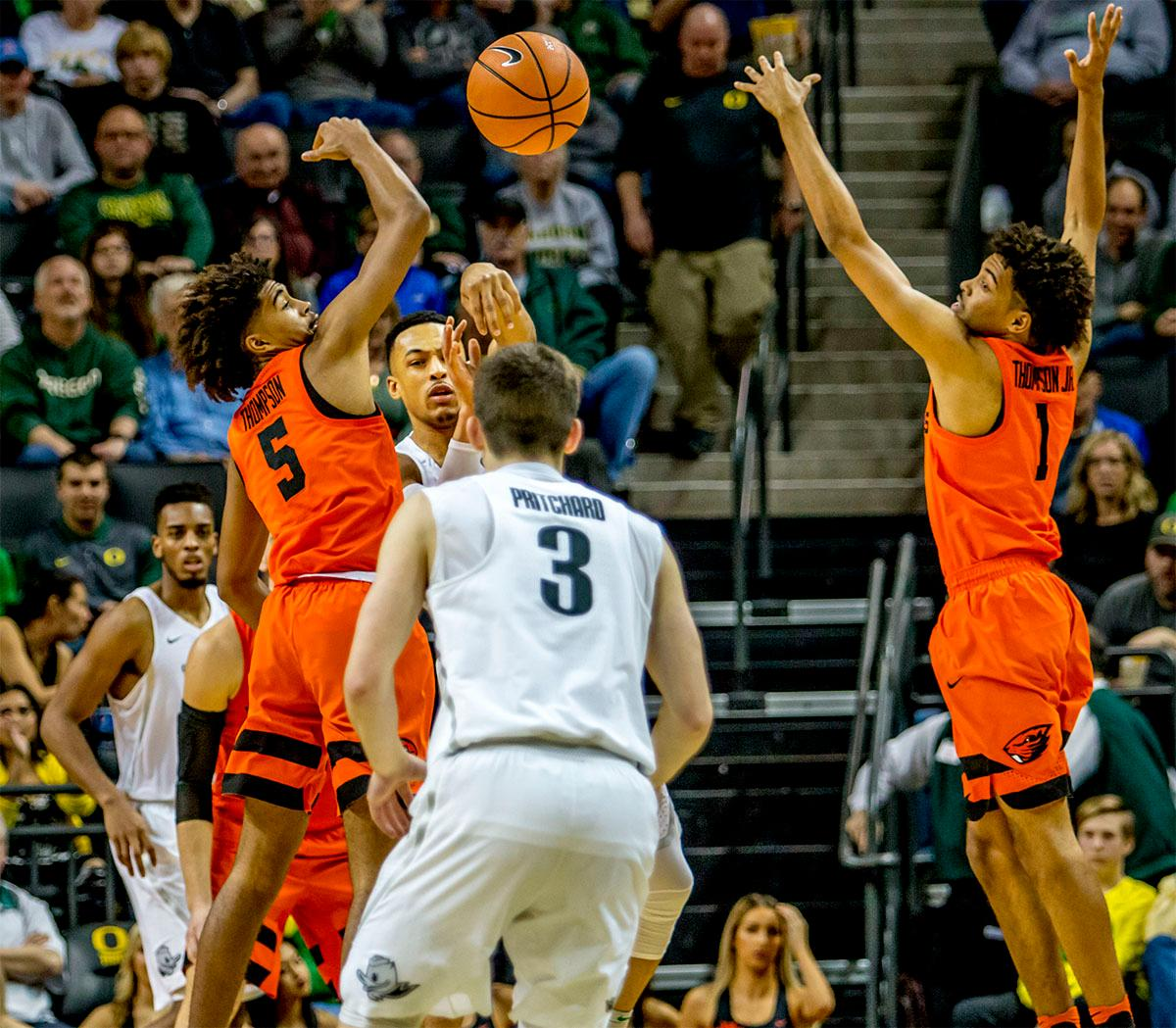 The Duck's Elijah Brown (#5) passes to teammate Payton Pritchard (#3). The Ducks defeated the Beavers in the civil war game, 66-57, at Matthew Knight Arena on Saturday night. Elijah Brown scored a game high of 20 points with 18 of the points coming in the first half, Paul White added 17 points. The Ducks are now 14-7 overall and 4-4 in conference play. The Ducks will next face California on Thursday Feb. 1 at 6:00 p.m. Photo by August Frank, Oregon News Lab