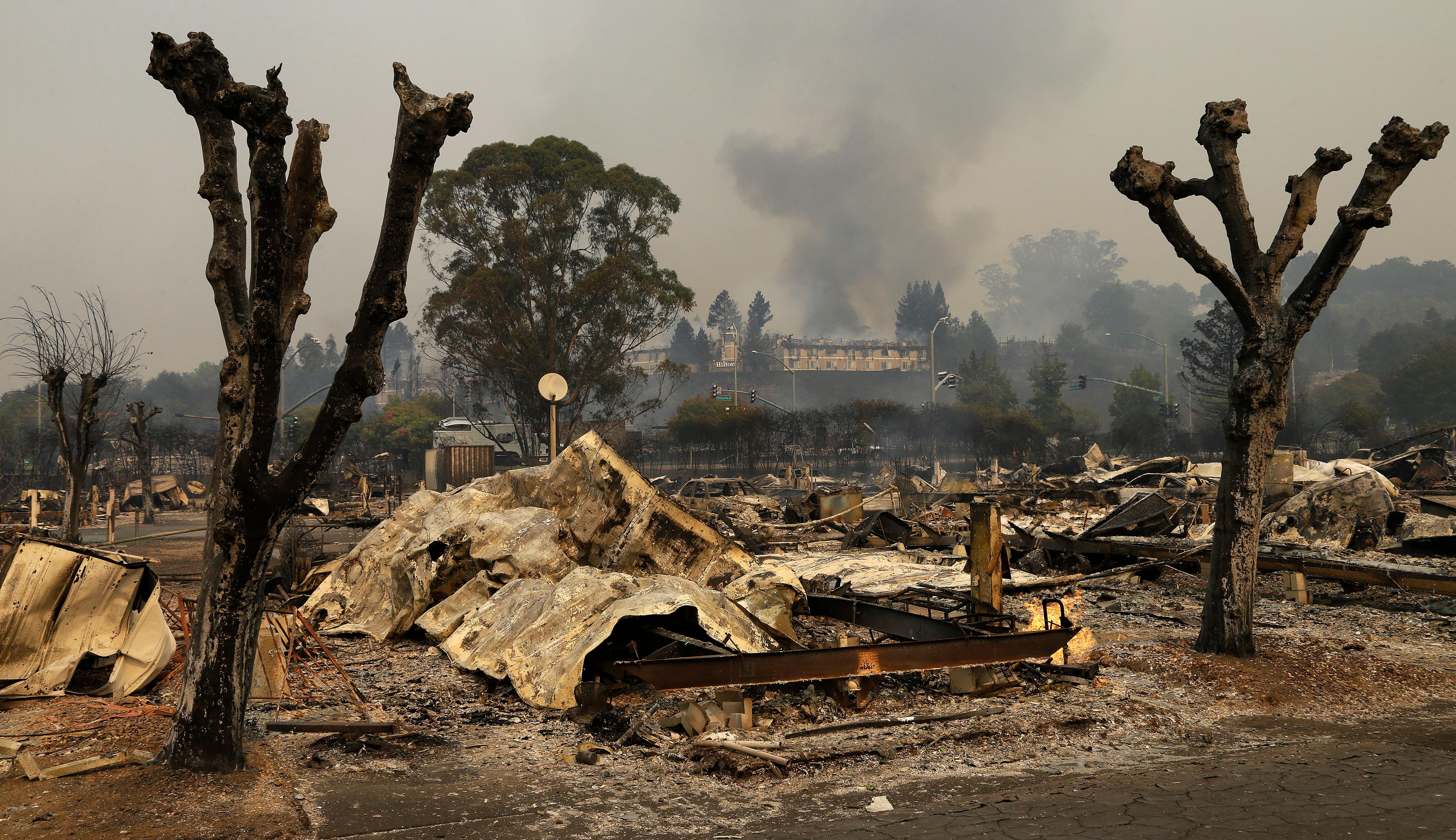 Remains sit at the Journey's End mobile home park on Monday, Oct. 9, 2017, in Santa Rosa, Calif. Wildfires whipped by powerful winds swept through Northern California, sending residents on a headlong flight to safety through smoke and flames as homes burned. (AP Photo/Ben Margot)